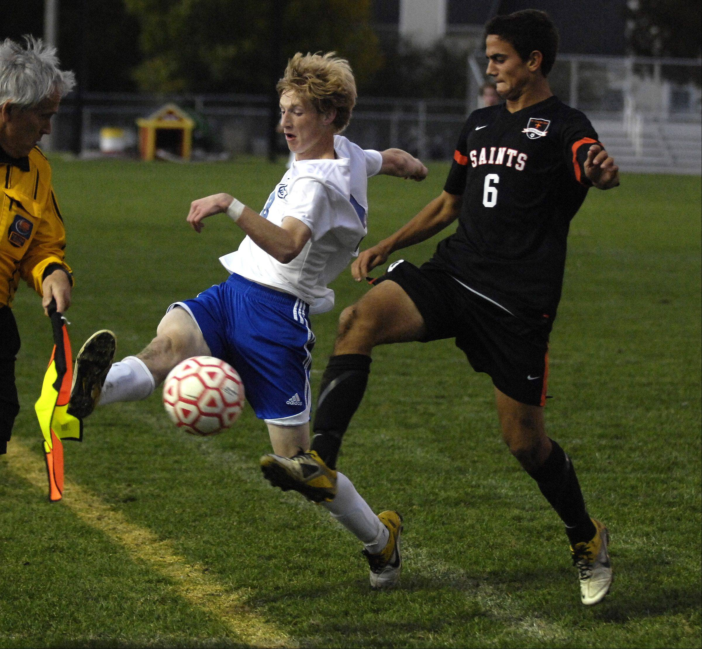 Geneva�s David Goodyear tries to keep the ball in play along the sideline as St. Charles East�s Michael Macek pressures during the Tri-Cities soccer challenge hosted by Batavia High School Thursday.
