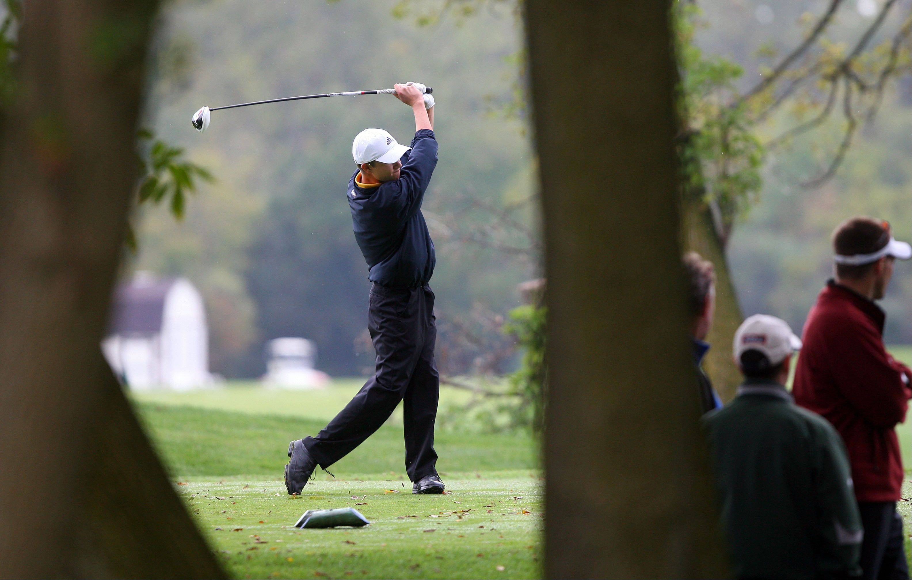Jacob�s Sean Kozak tees off on the 10th hole during the Fox Valley Conference boys golf meet at Pine Meadow Golf Course in Mundelein on Thursday.