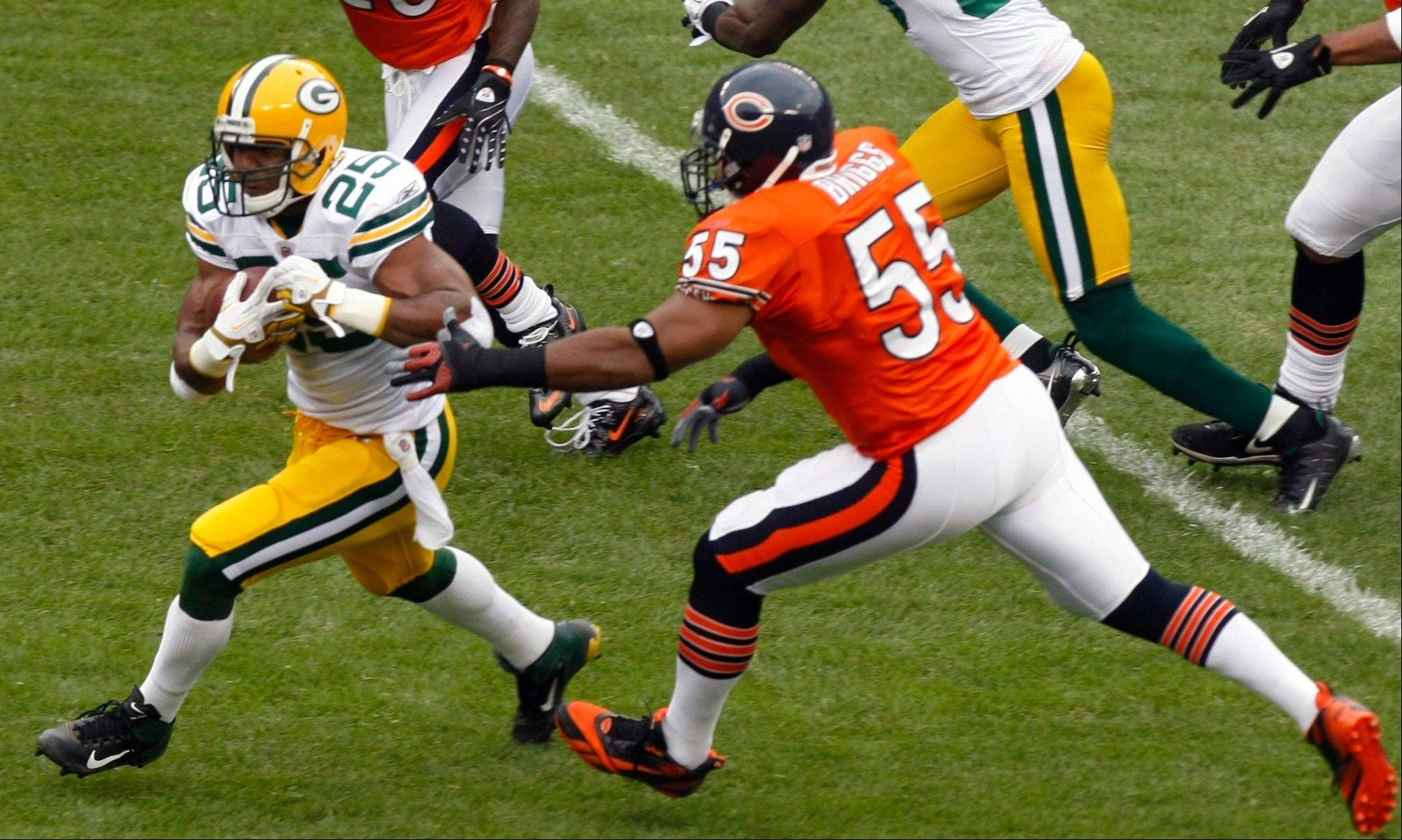 Lance Briggs chases down Packers running back Ryan Grant last Sunday at Soldier Field.