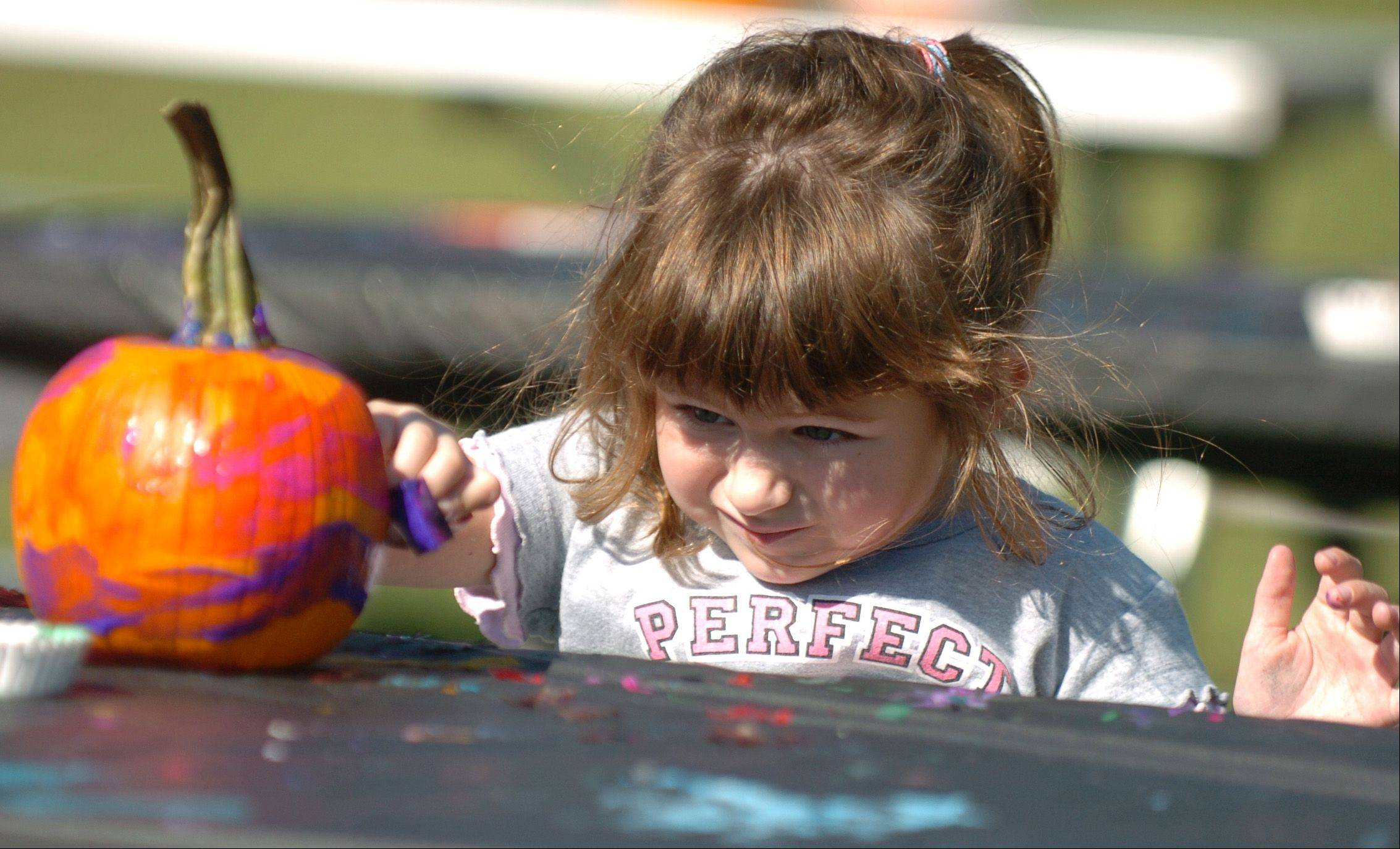 Decorating pumpkins is a favorite activity of visitors to Blackberry Farm in Aurora during Pumpkin Weekends in October.