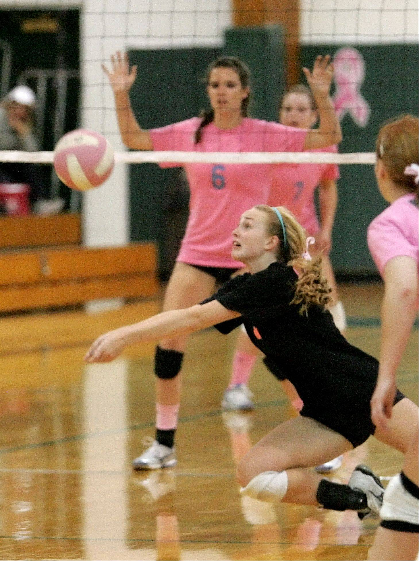 Caleigh Ryan, here diving for a ball against Willowbrook last season, has been central to Glenbard West's volleyball resurgence.
