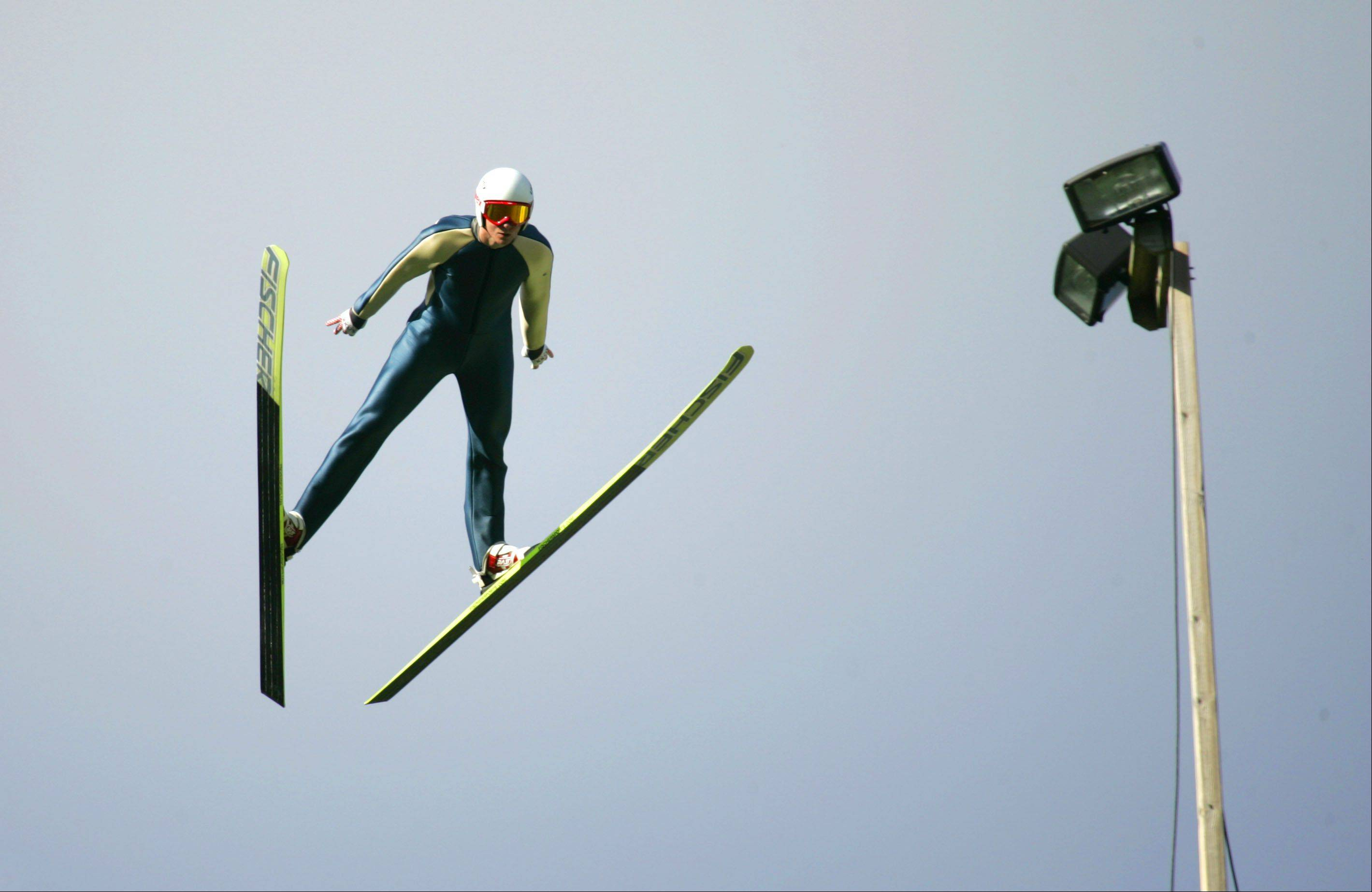 Peter Frenette, 19, a 2010 Olympian from Lake Placid, N.Y., launches from the ramp Friday during training day for the U.S. National Ski Jumping and Nordic Combined Championships at Norge Ski Club in Fox River Grove.