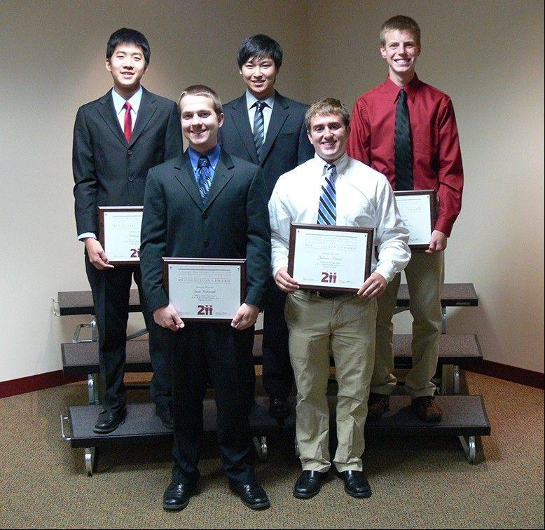 Six students were honored at a District 211 board meeting for scoring a perfect 36 on the ACT. Top row, from left: William Shih and Andrew Song, both of Fremd High School, and Ryan Erdmann of Palatine High School. Bottom row, from left: Scott Kirkwood and Jackson Mitzner, both of Fremd. Mengran Liu of Hoffman Estates High School also had a perfect score.