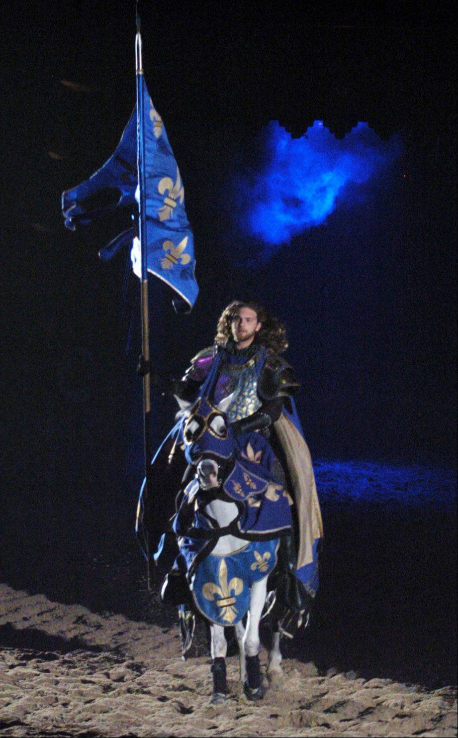 The Blue Knight makes his entrance during a matinee performance at Medieval Times.