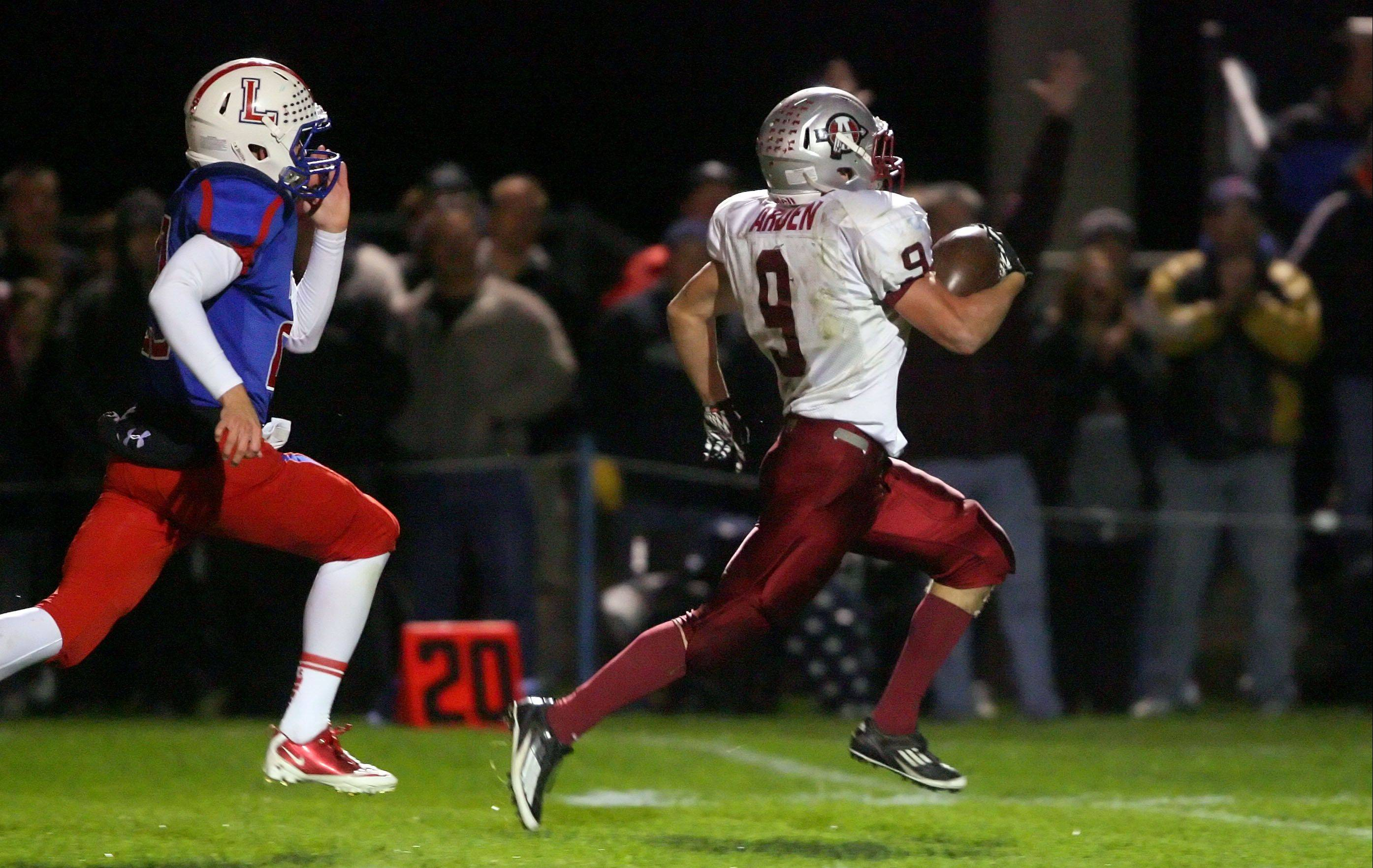 Antioch�s Danny Arden, right, stays ahead of Lakes� Levi Haymaker for a touchdown during Friday night in Lake Villa.