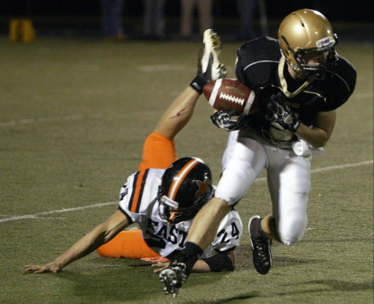 Streamwood�s Austin Mugnai breaks St. Charles East�s Tim Leibforth�s tackle Friday at Streamwood High School.