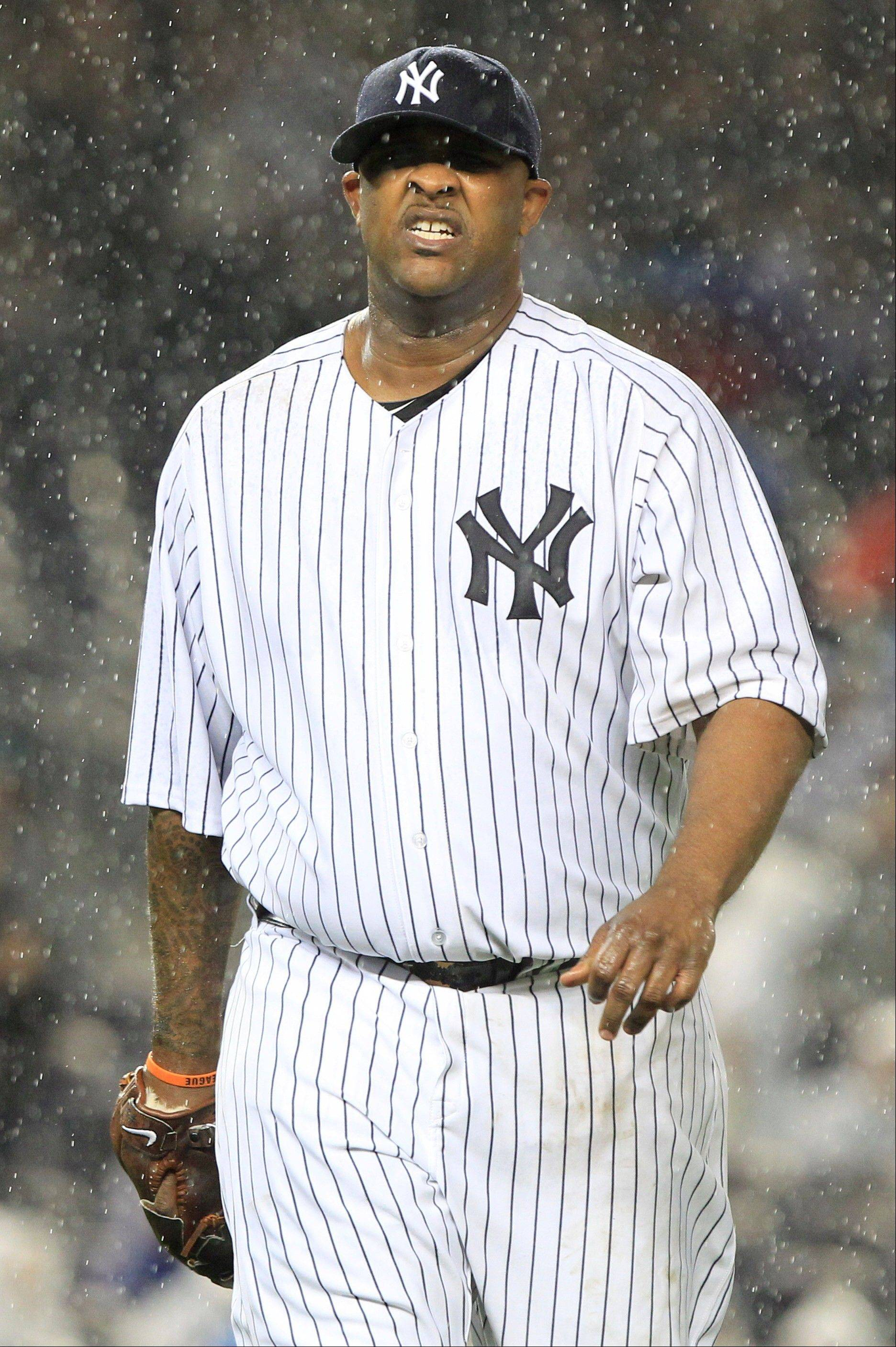 New York Yankees starting pitcher CC Sabathia is waterlogged after an inning of work in the opening game of the ALDS between the Yankees and Detriot Tigers. The game was suspended in the second inning due to rain and will resume at 7:37 p.m. Saturday night.