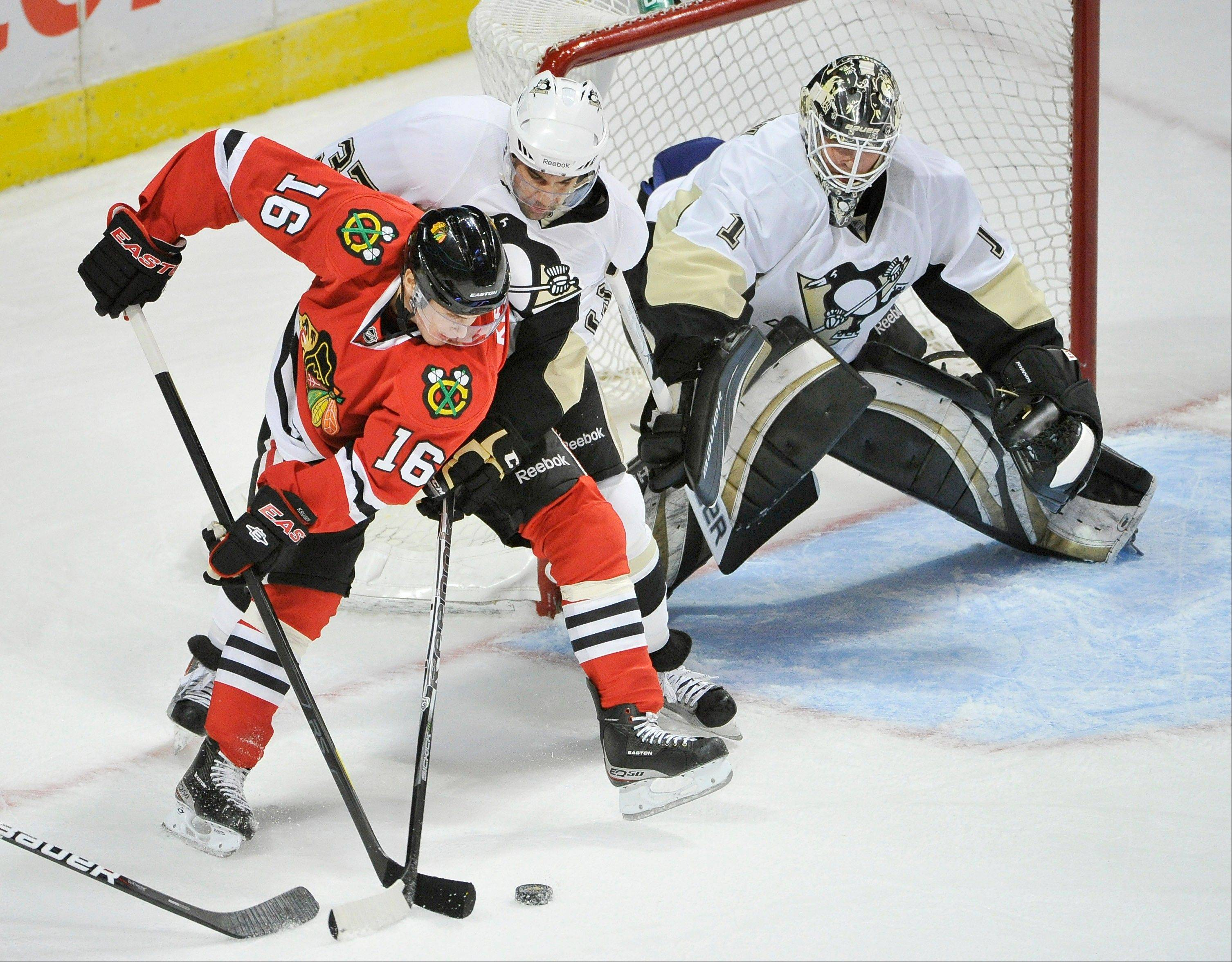 The Blackhawks� Marcus Kruger tries to score against Penguins defenseman Brian Strait and goalie Brent Johnson on Friday during preseason action at the United Center.