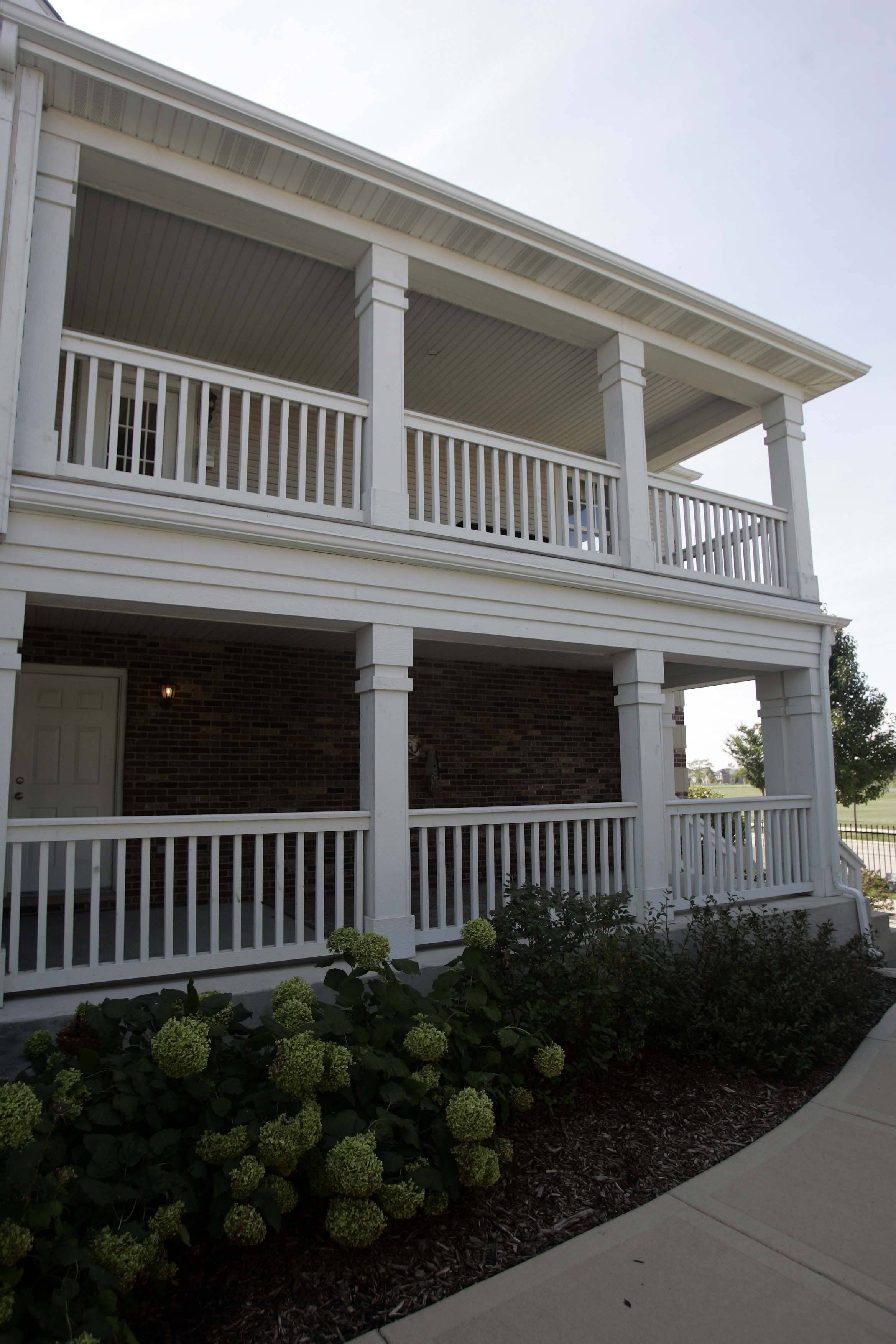 The double-decker porch on the Princeton model is just one of the many porches at West Point Gardens in Elgin.