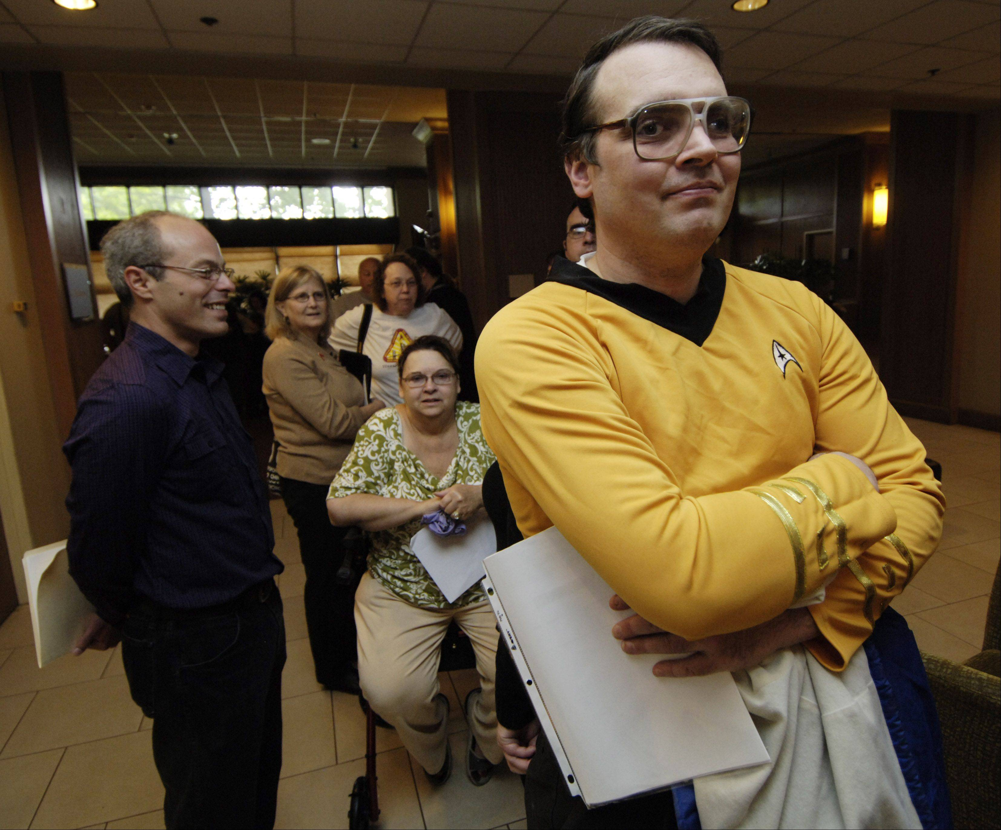 John Lang of McHenry waits to enter the Star Trek convention at the Westin O'Hare in Rosemont Friday. Note the yellow shirt, which designates him as command (Redshirts, meanwhile, almost always die on the alien planet).