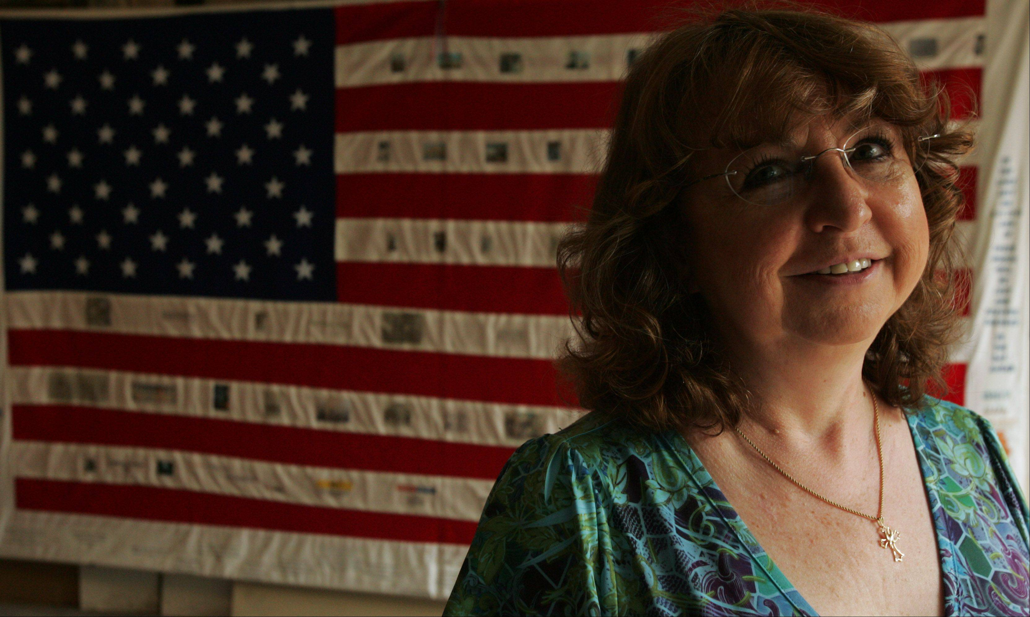 Paula Eaton of South Elgin hopes to have her homemade 9/11 flag displayed somewhere permanently, perhaps even at the 9/11 memorial museum near ground zero. She created the flag 10 years ago as a way to channel her feelings of helplessness during and after the attacks.