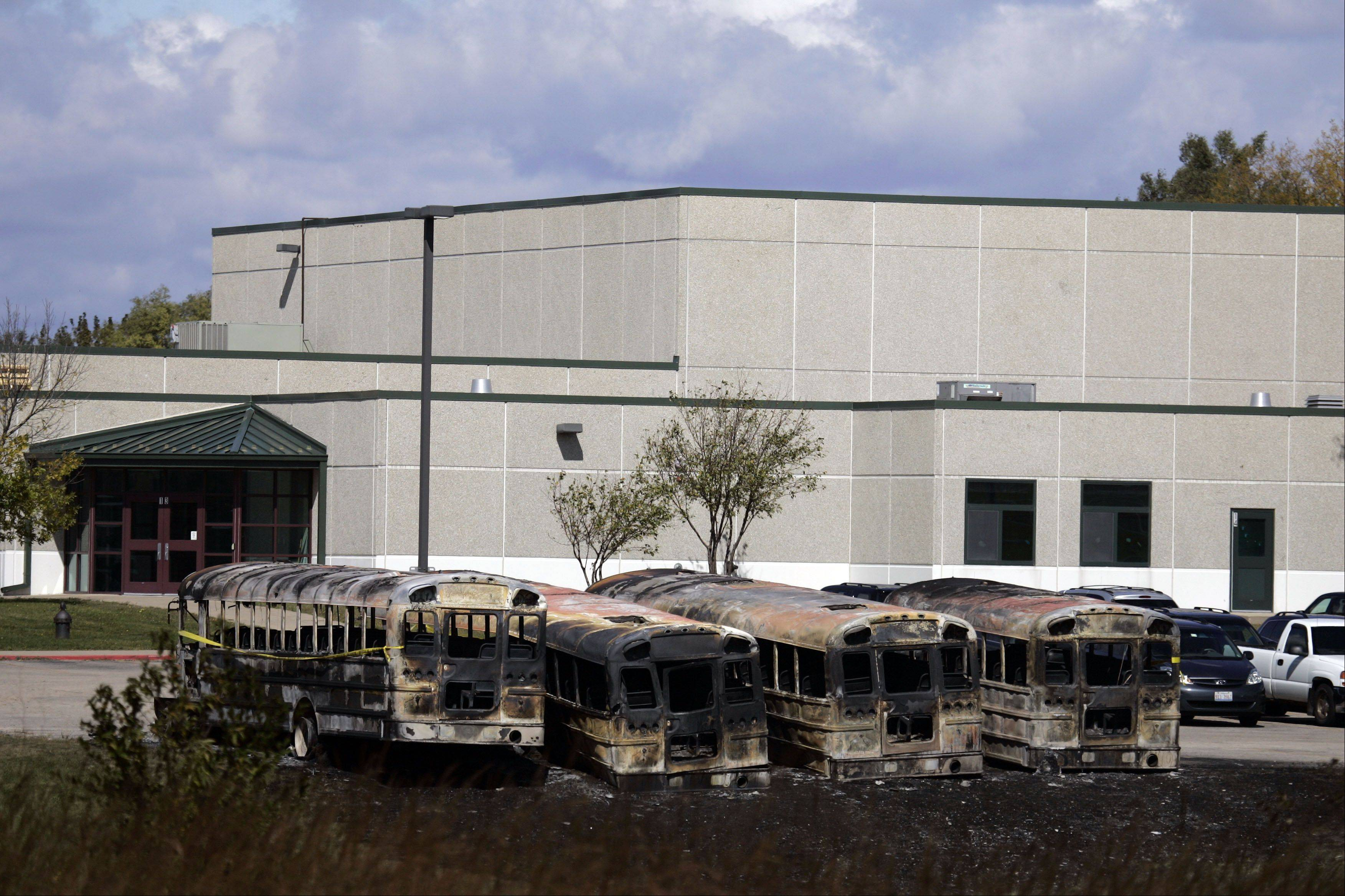 Brian Hill/bhill@dailyherald.comBuses destroyed by fire sit in the parking lot Friday afternoon at Prairie View Grade School on Nesler Road. Foul play is expected, according to the Kane County Sheriff's Department.