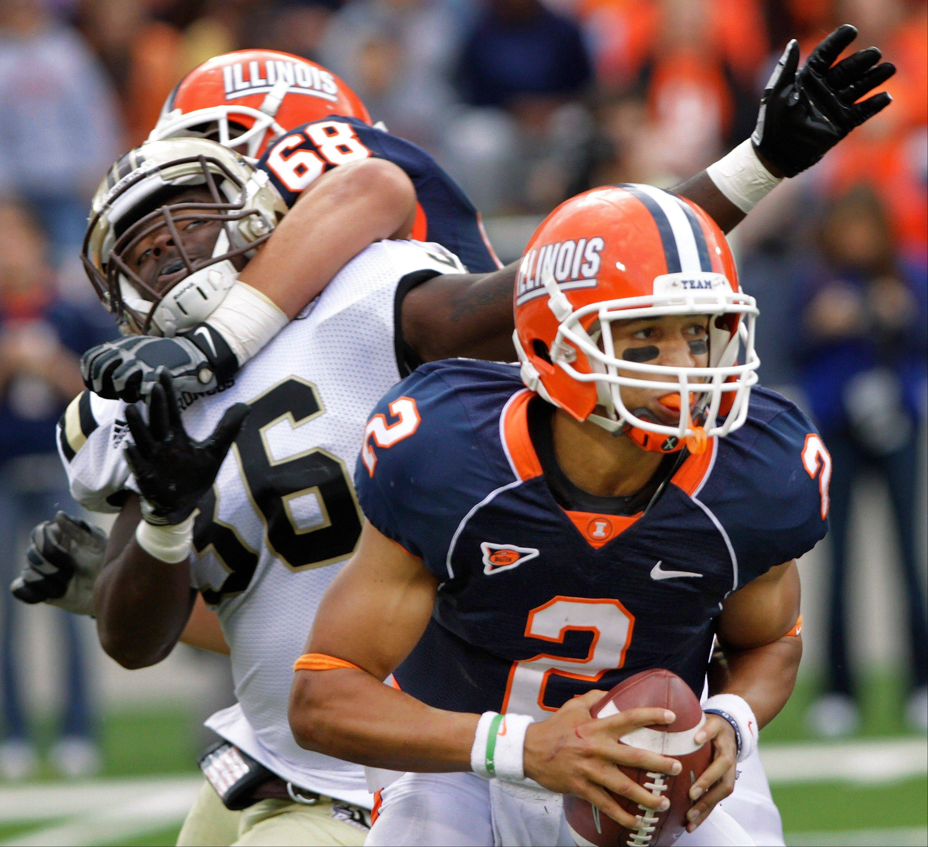 Illinois offensive linesman Simon Cvijanovic (68) blocks Western Michigan defensive end Deauntay Legrier (36) while Illinois quarterback Nathan Scheelhaase (2) looks to pass last week in Champaign.