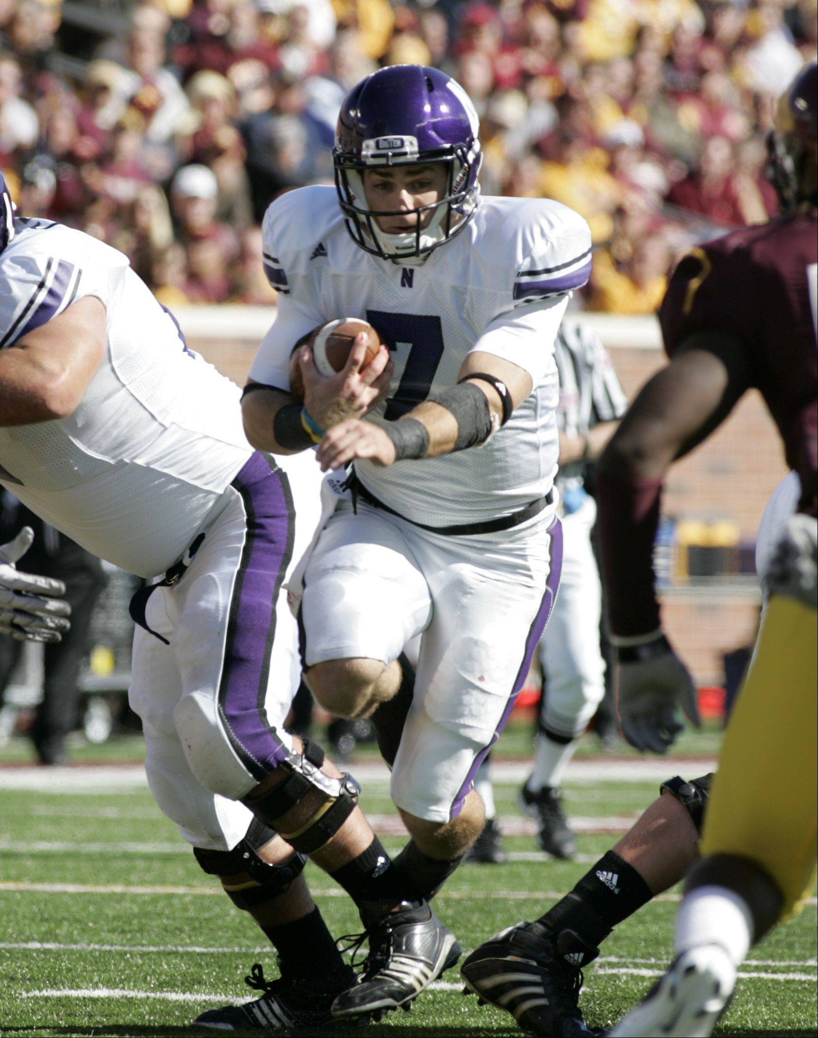 Northwestern quarterback Dan Persa runs for a short gain against Minnesota during the first half of an NCAA football game, Saturday Oct. 2, 2010 in Minneapolis. Persa ran for a team high 99 yards on the day as Northwestern won 29-28.