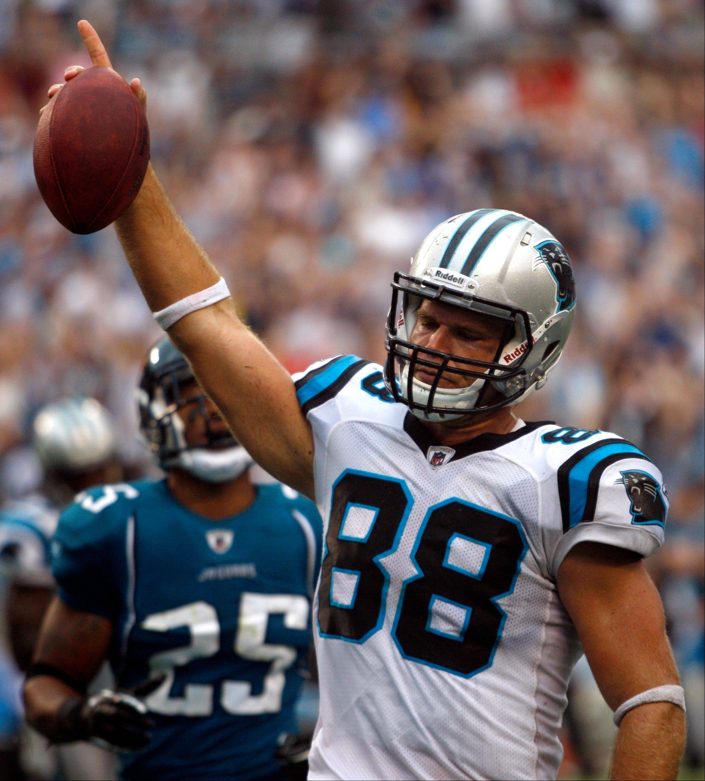 Carolina Panthers tight end Greg Olsen celebrates his touchdown catch against Jacksonville last week, which gave the team its first win of the season. Olsen will face the Bears, his former team, on Sunday at Soldier Field.
