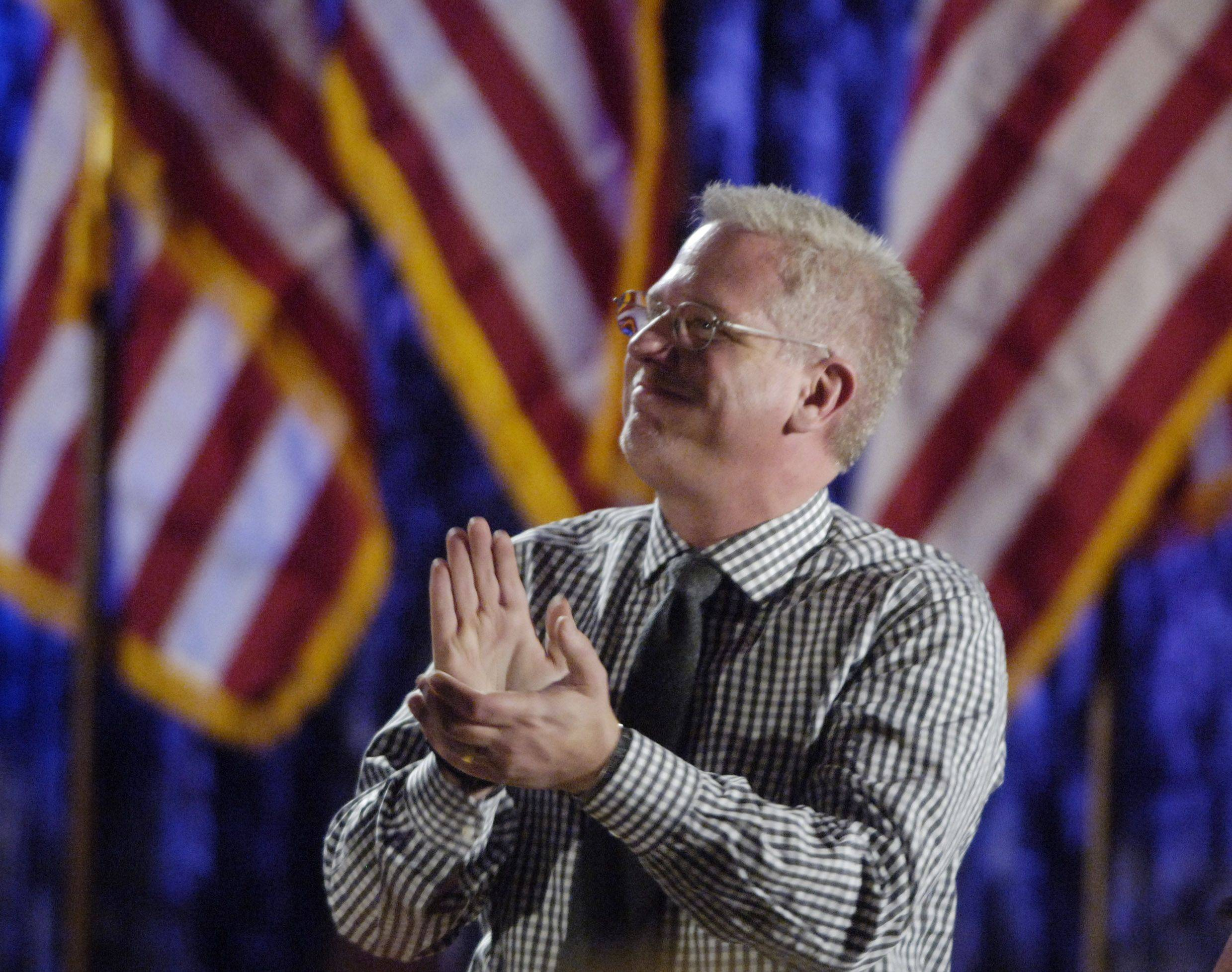 Glenn Beck shows his appreciation to speakers preceding himself at the podium during dinner at TeaCon, the Tea party Convention in Schaumburg Saturday.