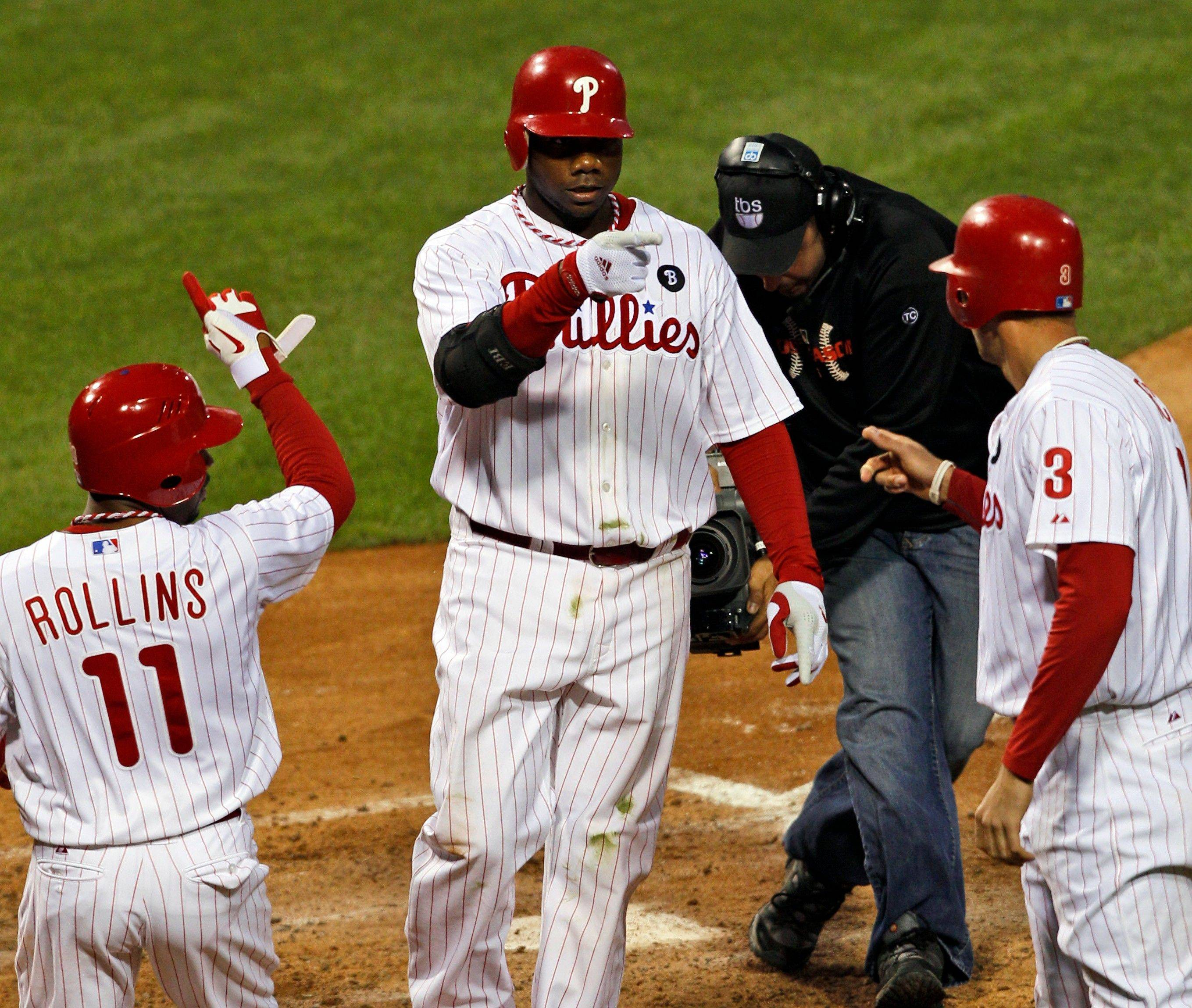 Ryan Howard's big homer helped the Philedelphia Phillies overcome a shaky start by pitcher Roy Halladay and take Game 1 of the NLDS as they topped the St. Louis Cardinals 11-6.