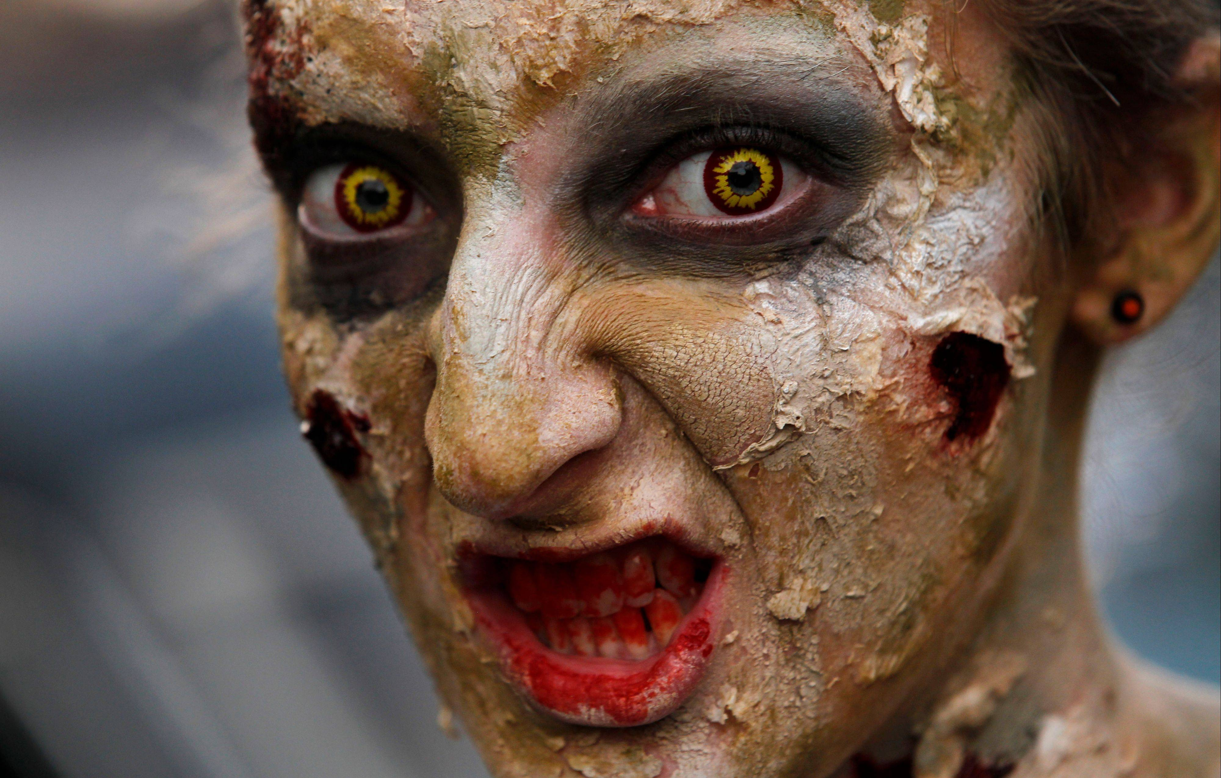 An actor in costume and makeup awaits visitors to the House of Shock, a haunted house, in New Orleans. Halloween-season attractions like House of Shock are big business.