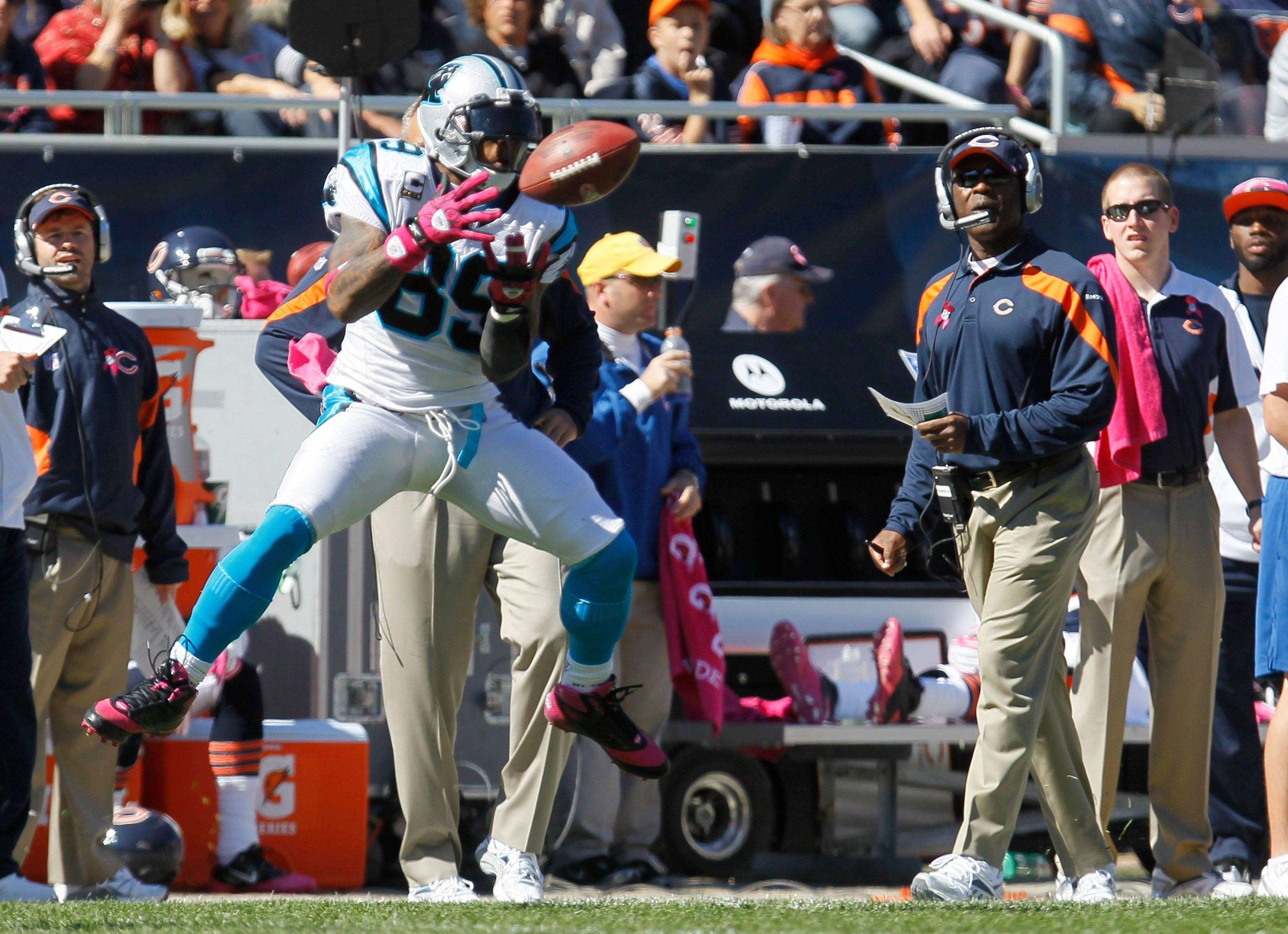 Panthers wide receiver Steve Smith makes a reception in front of Bears coach Lovie Smith in the first half Sunday.