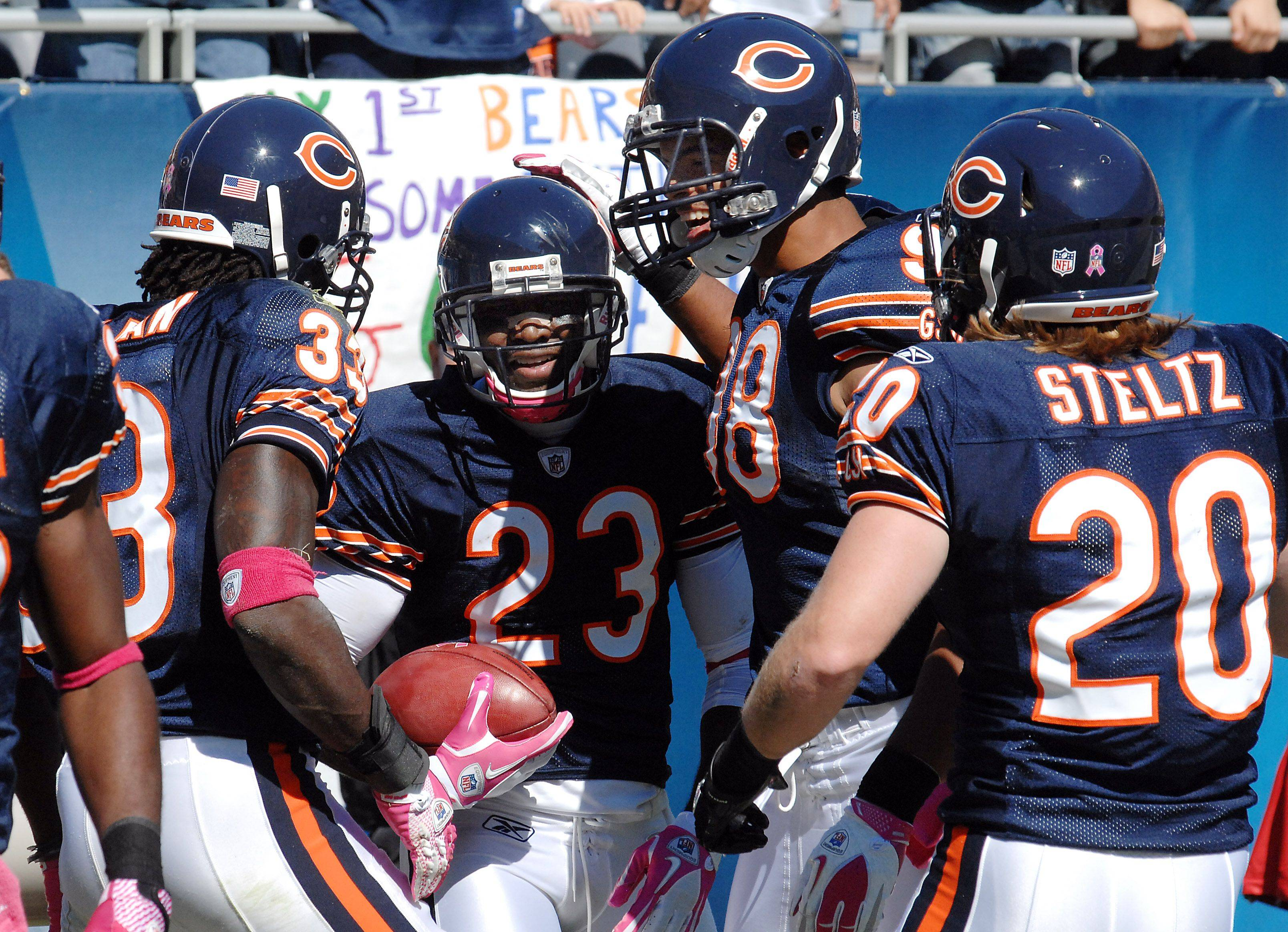 Bears Devin Hester runs back a second quarter punt return for a touchdown and an NFL record against the Panthers.