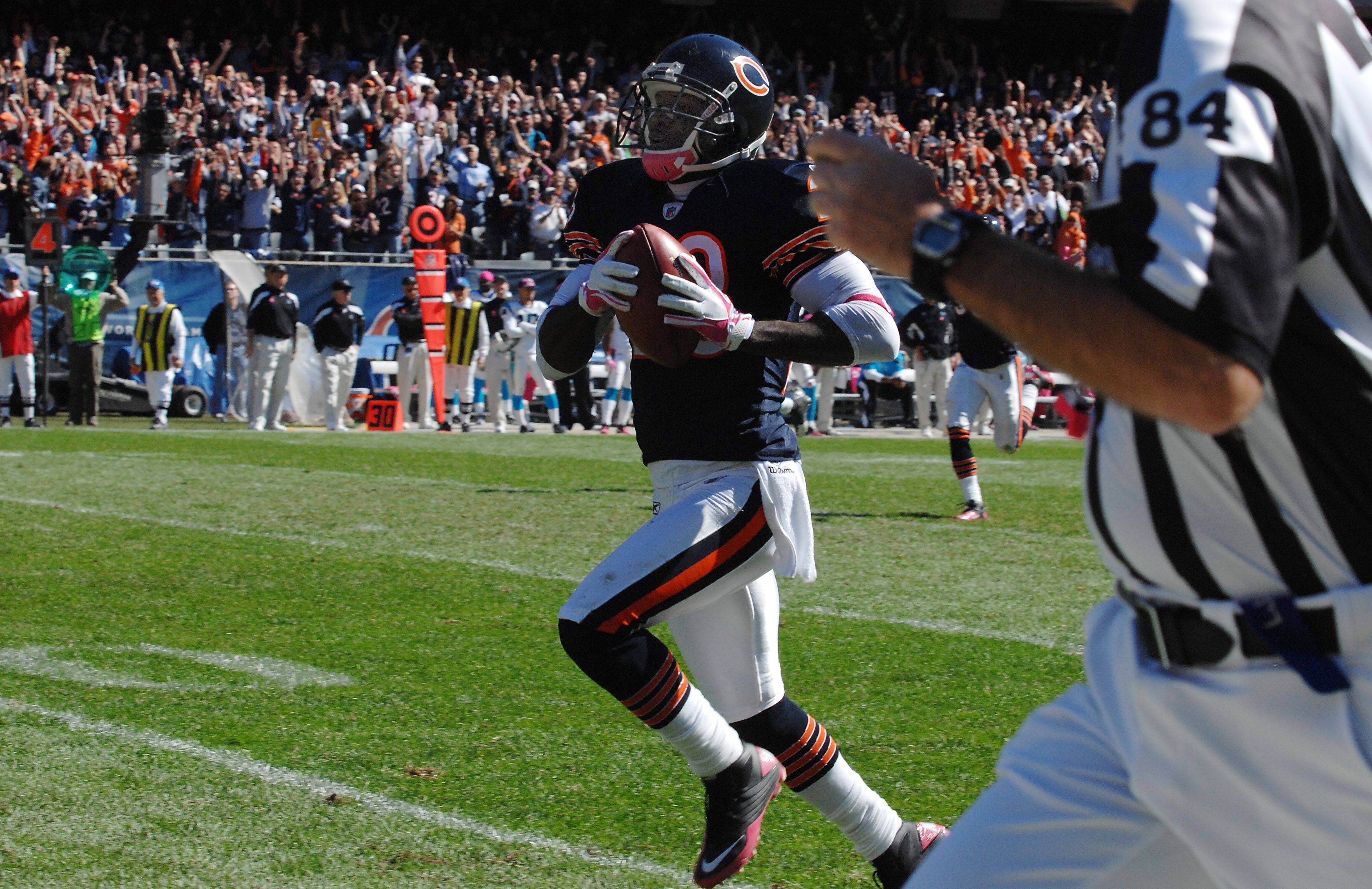 Bears Devin Hester runs back a second quarter punt return for a touchdown and an NFL record against the Panthers defense at Soldier Field on Sunday.