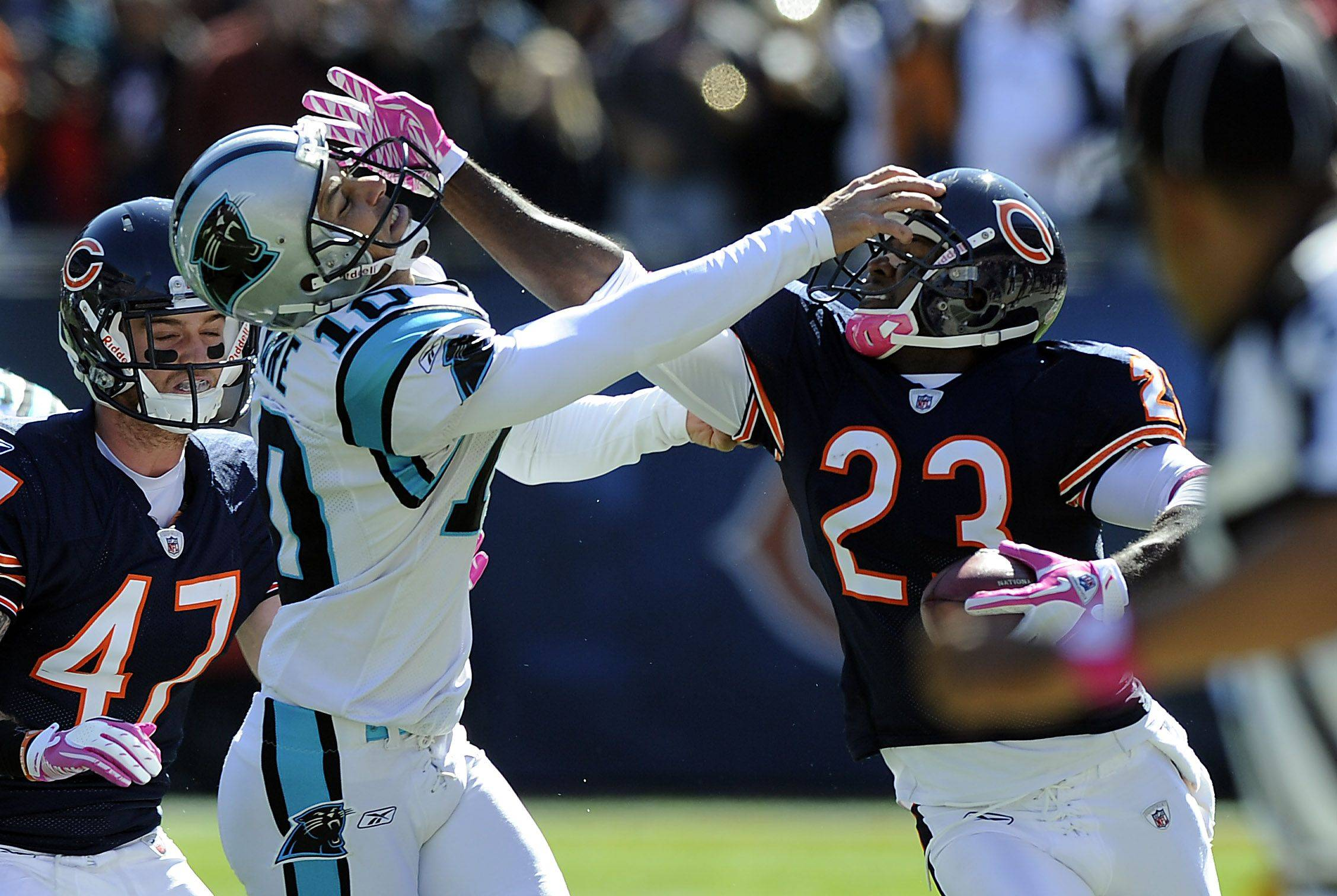 Bears Devin Hester runs back a second quarter punt return for major yardage as he battles Panthers Olindo Mare setting up a touchdown for Matt Forte at Soldier Field on Sunday.