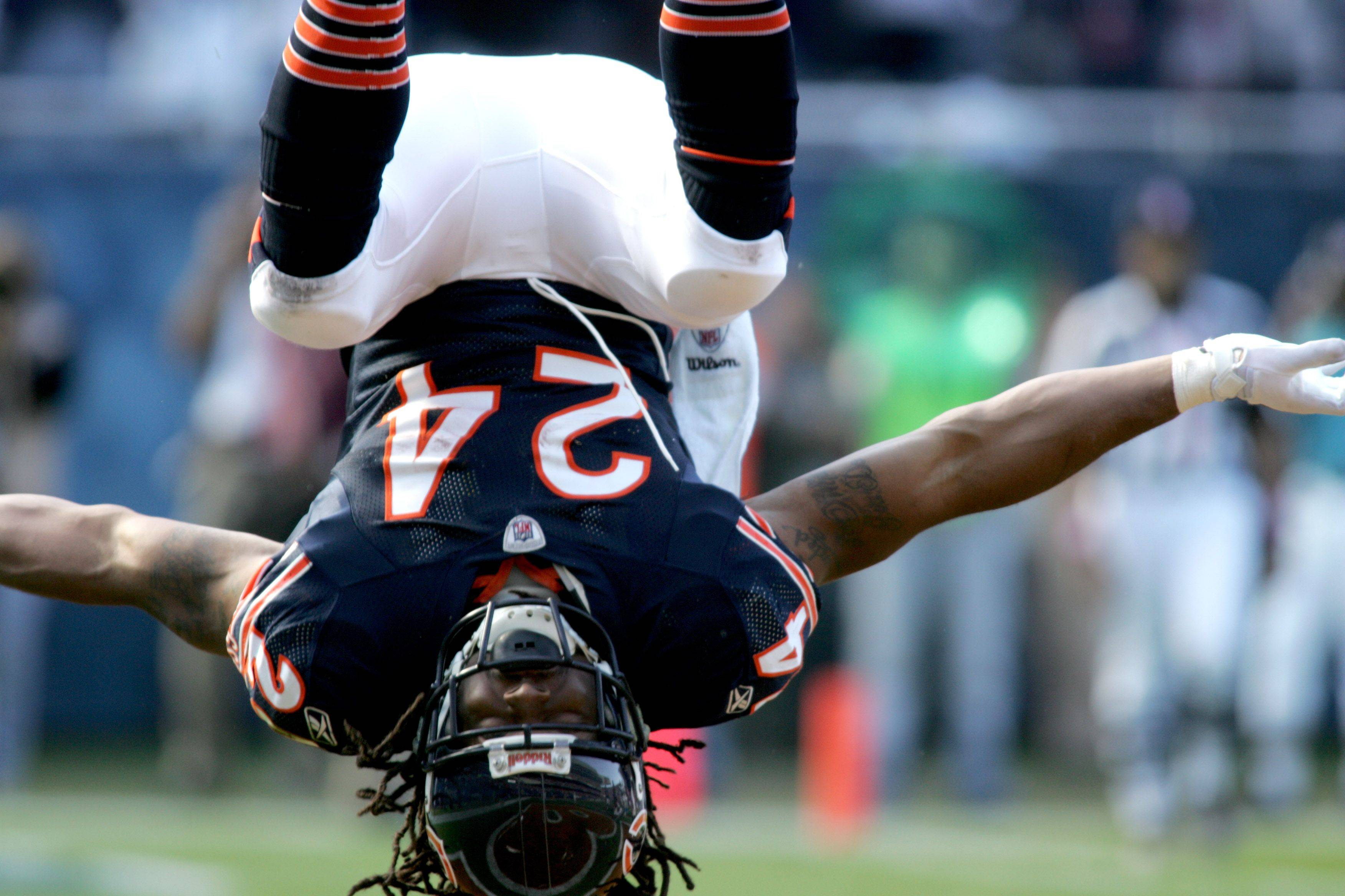 Marion Barber of the Chicago Bears does a flip after making his first touchdown for the team in the fourth quarter against the Carolina Panthers at Soldier Field on Sunday.