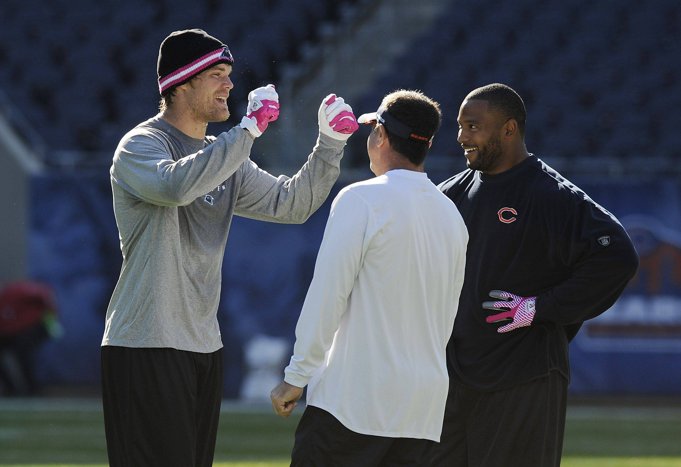 Former Chicago Bears Greg Olsen talks with Chicago Bears Lance Briggs (right) before the game.