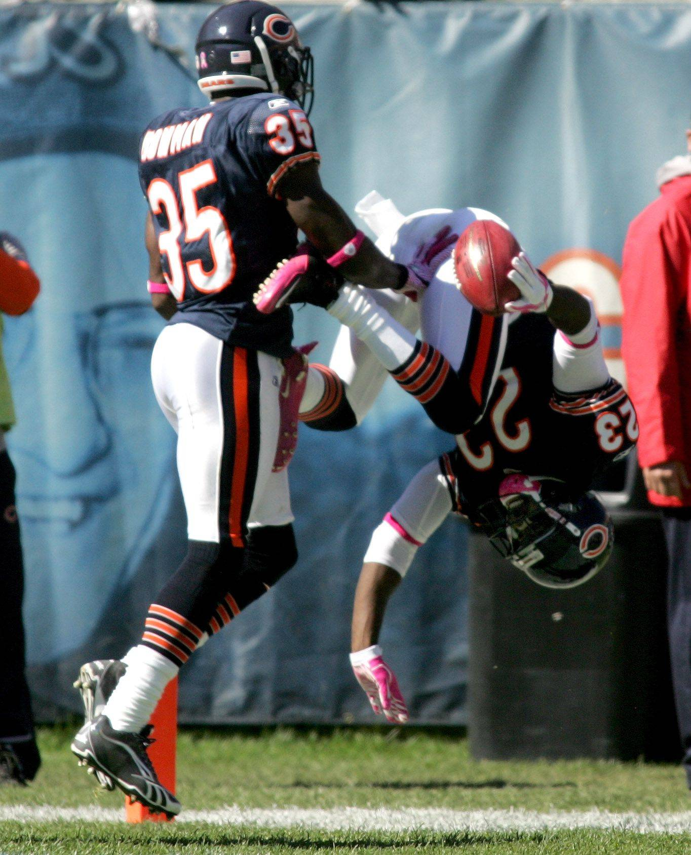 Devin Hester of the Chicago Bears makes a flip as he makes a touchdown in the 2nd quarter against Carolina Panthers.