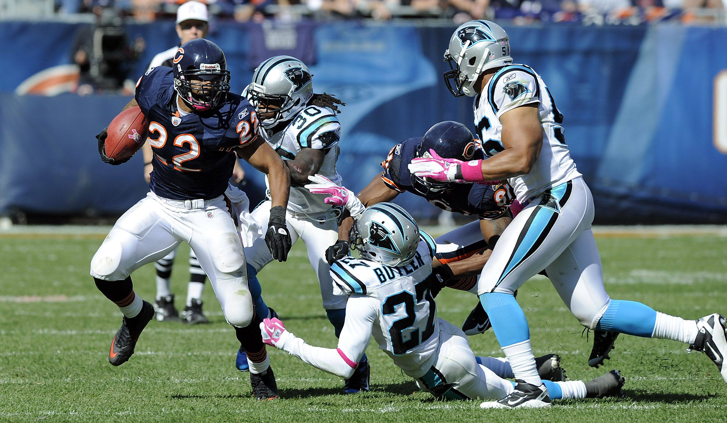 Bears Matt Forte on the run in the 4th quarter run against the Panthers defense at Soldier Field in Chicago.