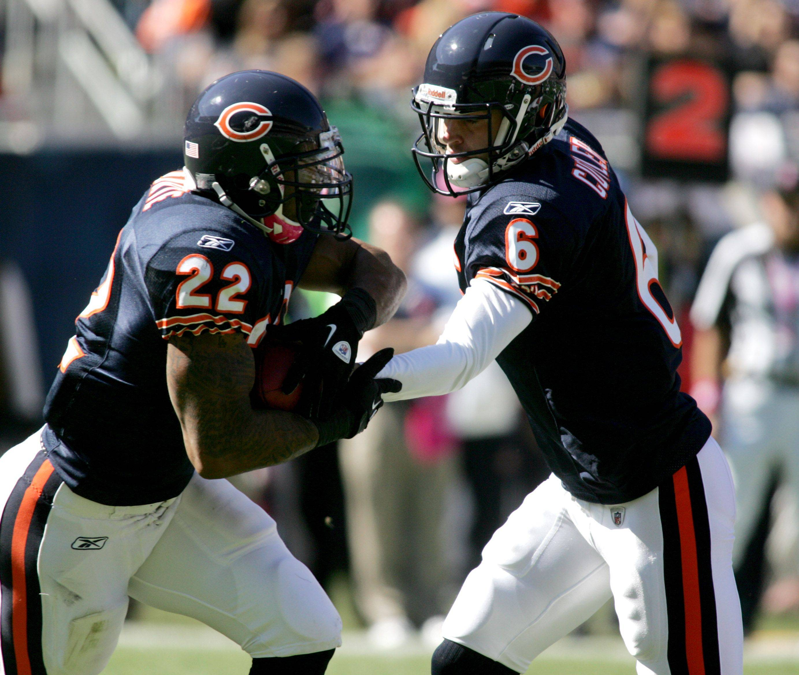 Jay Cutler hands off to Matt Forte of the Chicago Bears in action against the Carolina Panthers at Soldier Field on Sunday.
