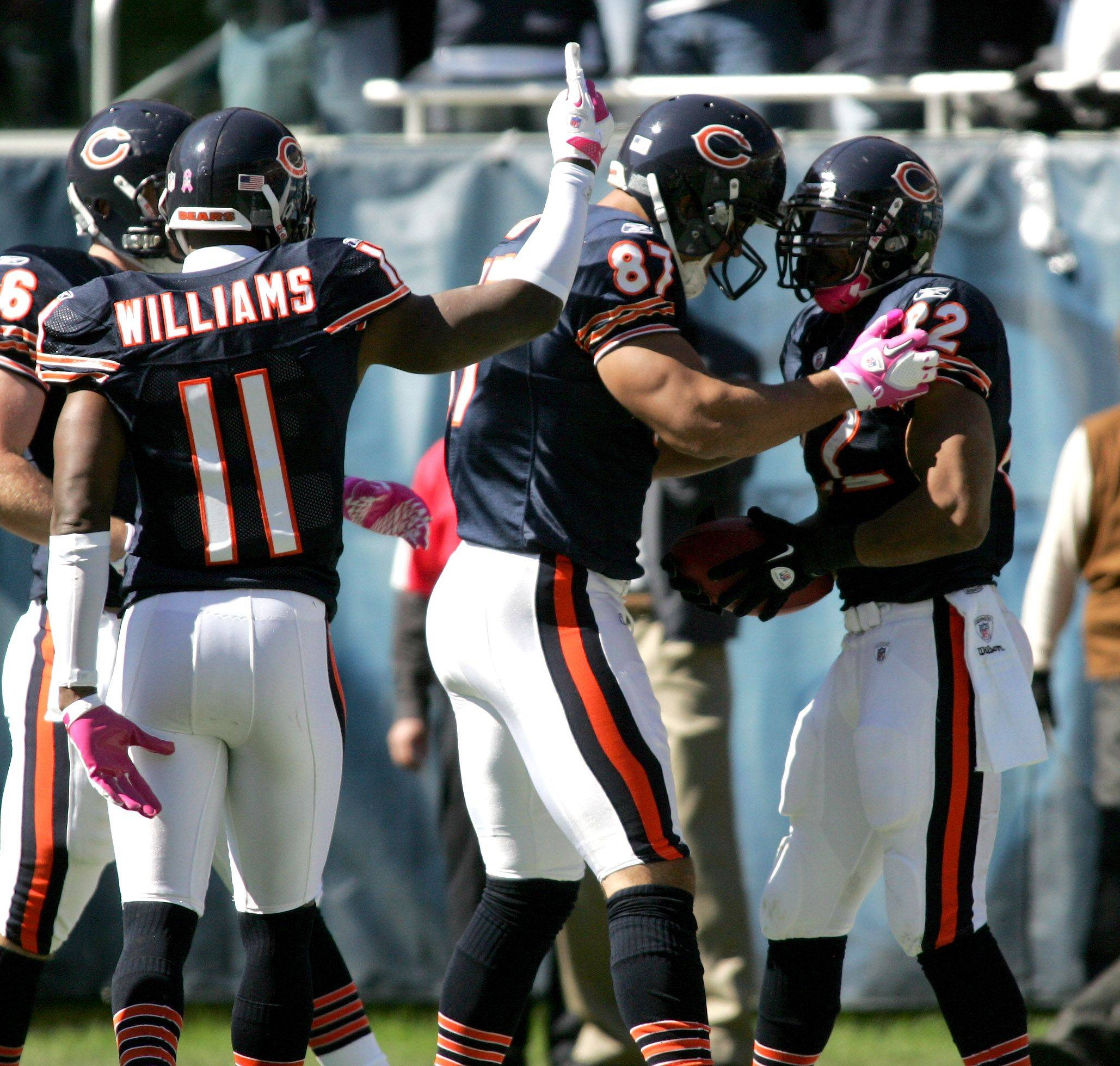 The Chicago Bears celebrate a touchdown by Matt Forte, right, in the second quarter against the Carolina Panthers.