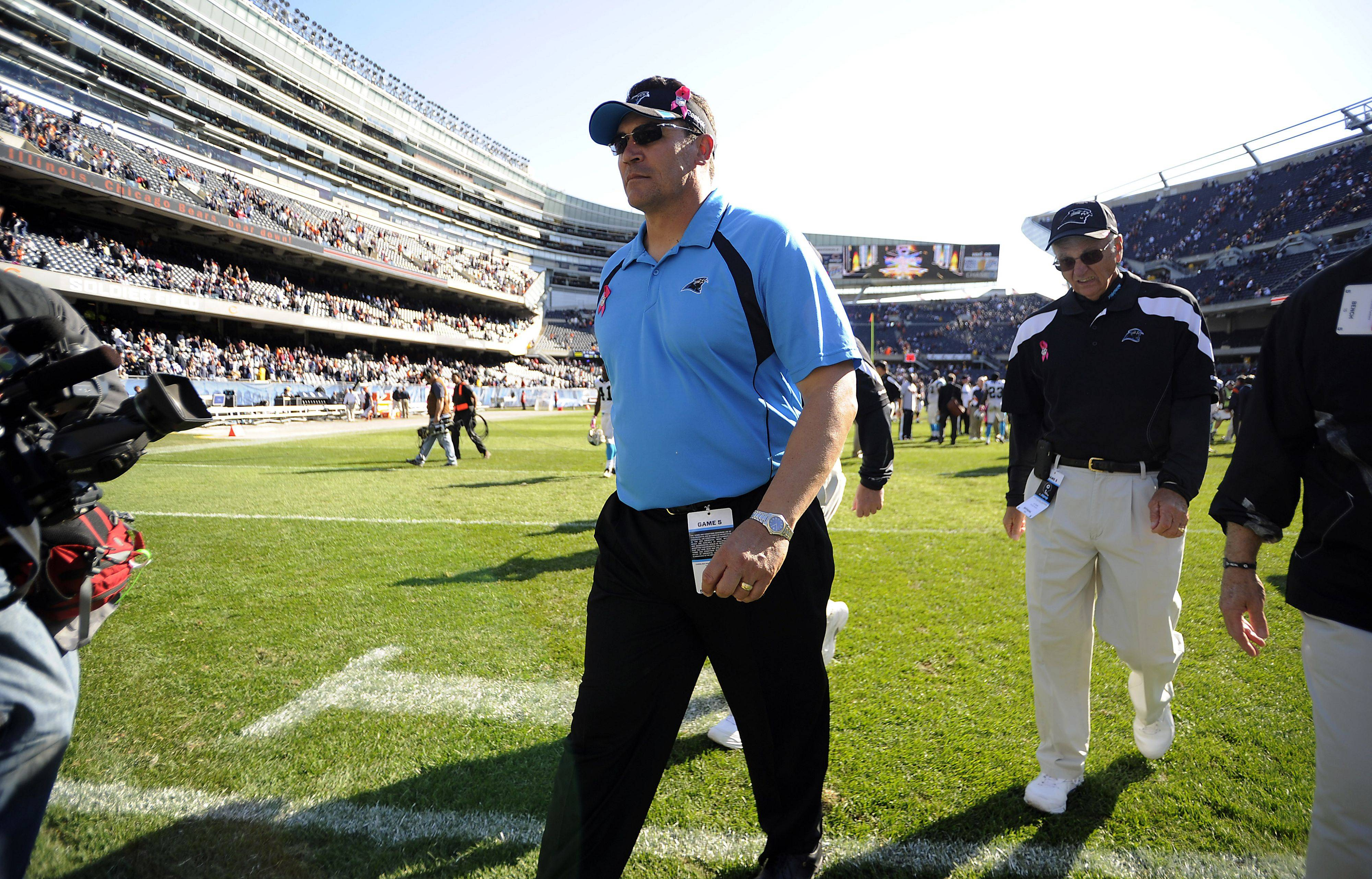 Former Bears player Ron Rivera, head coach for the Panthers walks off Soldier Field after his loss to the Bears.