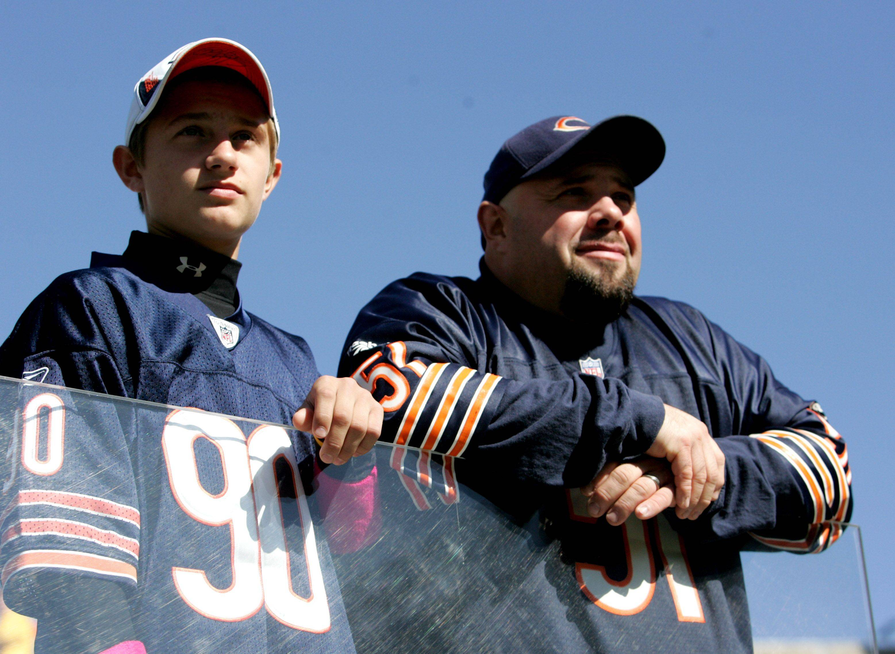 Justin Robles and his dad Jason Robles of Pingree Grove, wait for the start the Chicago Bears vs. Carolina Panthers game at Soldier Field on Sunday.