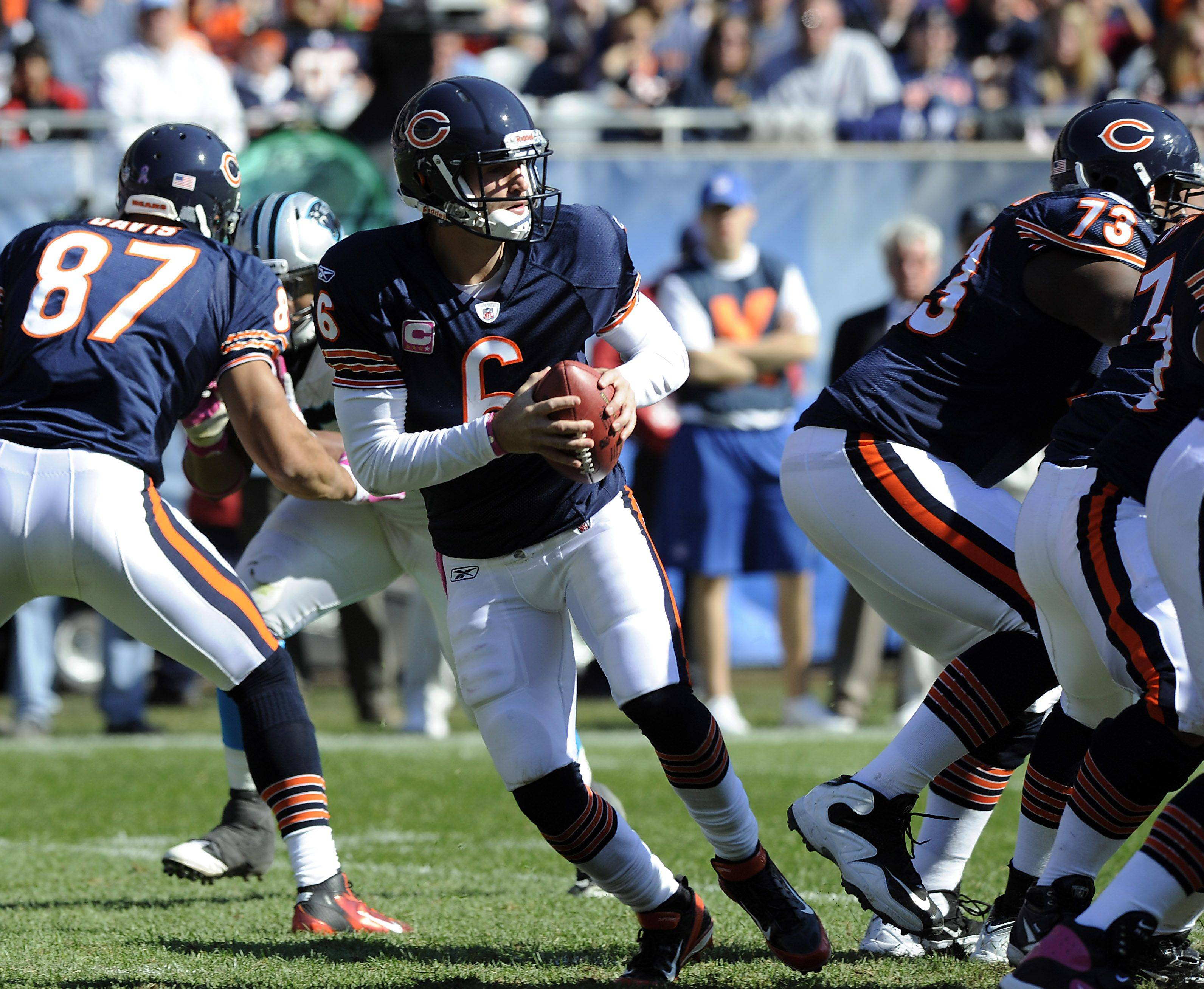 Bears quarterback Jay Cutler falls back in the pocket under pressure and throws his first interception of the game against the Panthers.