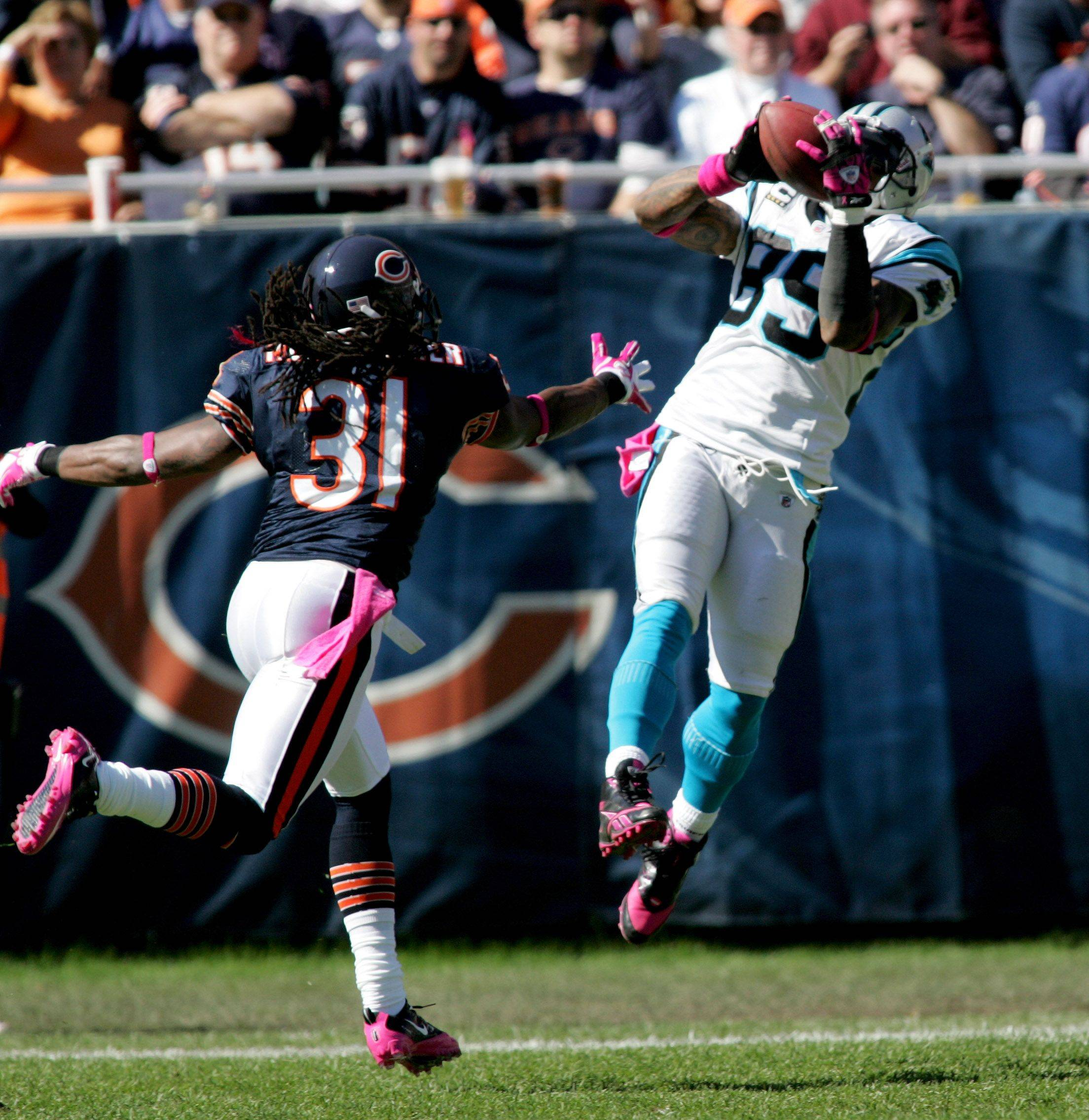 Brandon Meriweather of the Chicago Bears, left, defends as Steve Smith of the Carolina Panthers makes a catch.