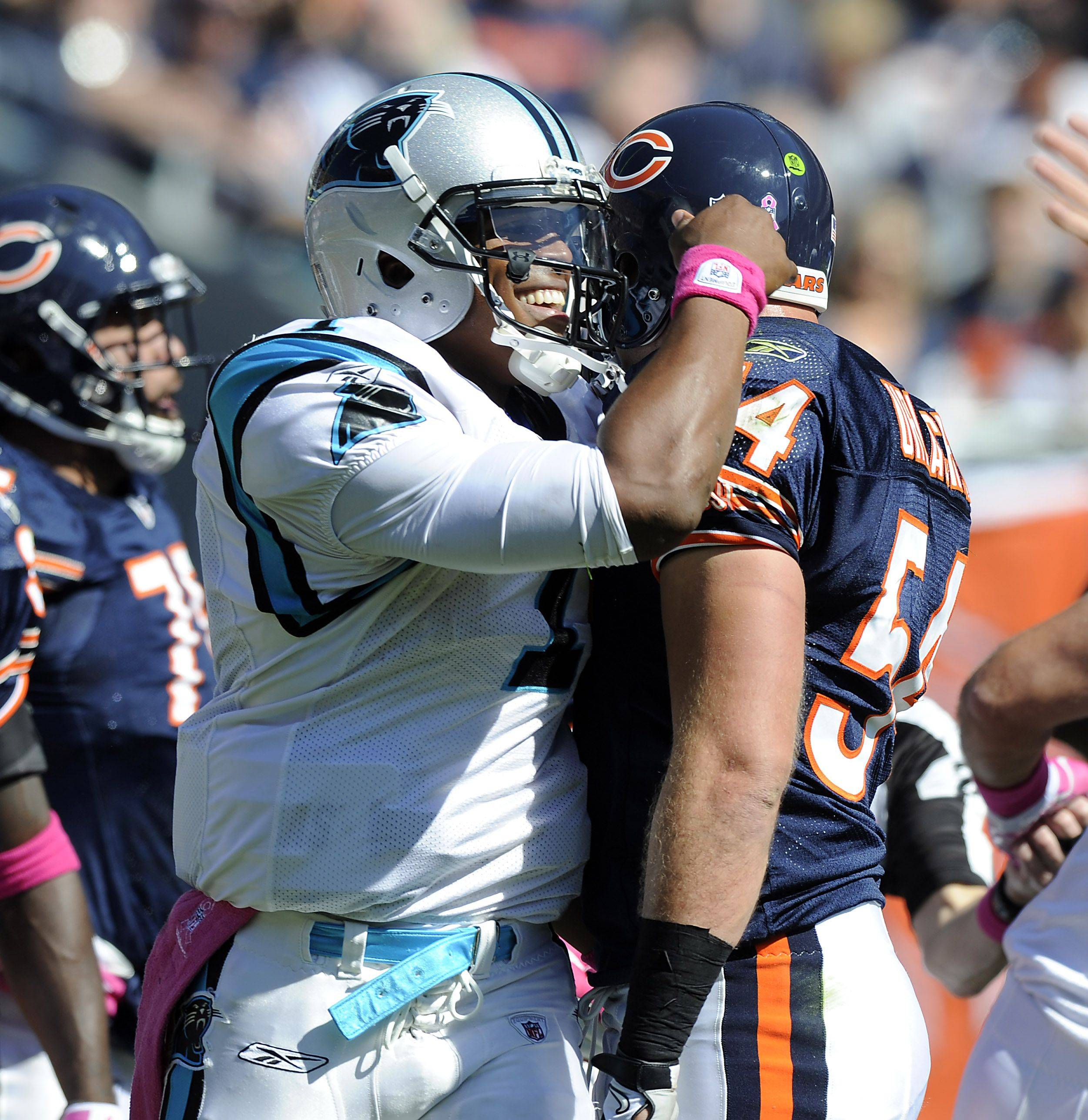 Panthers quarterback Cam Newton pats Bears Brian Urlacher after a play in the first half at Soldier Field.