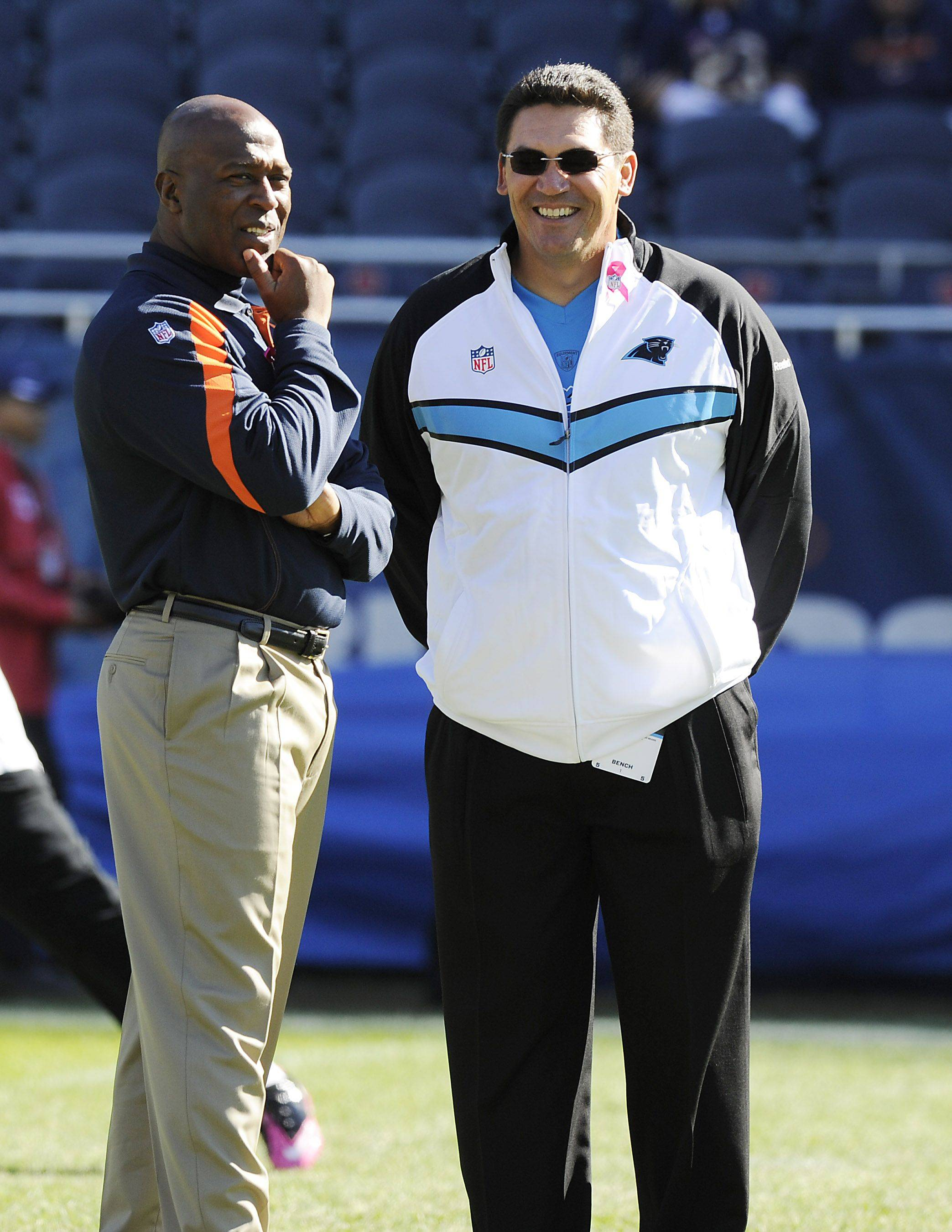 Chicago Bears coach Lovie Smith greets Panthers head coach Ron Rivera before the game as they get ready to play at Soldier Field in Chicago.