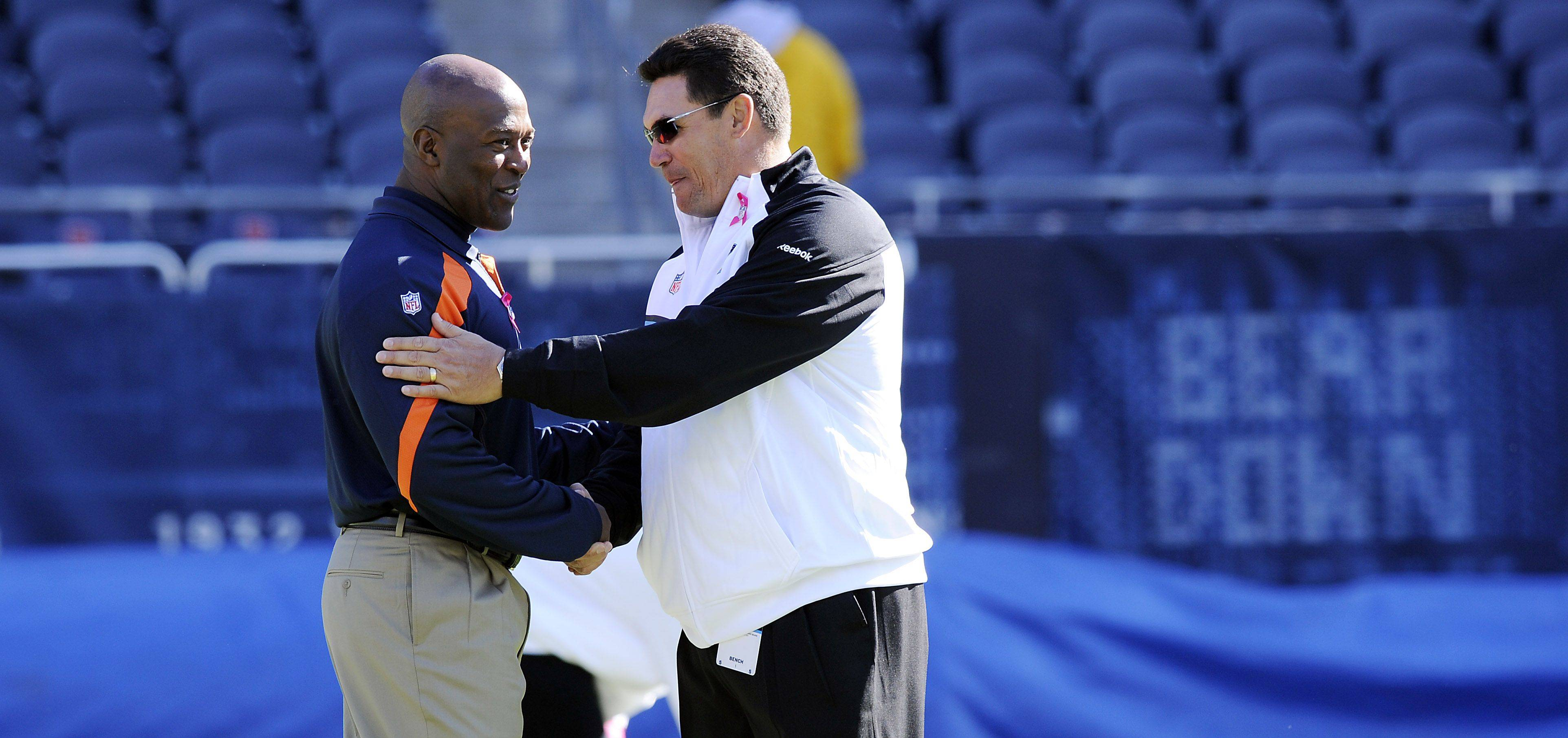 Chicago Bears coach Lovie Smith greets Panthers head coach Ron Rivera before the game.