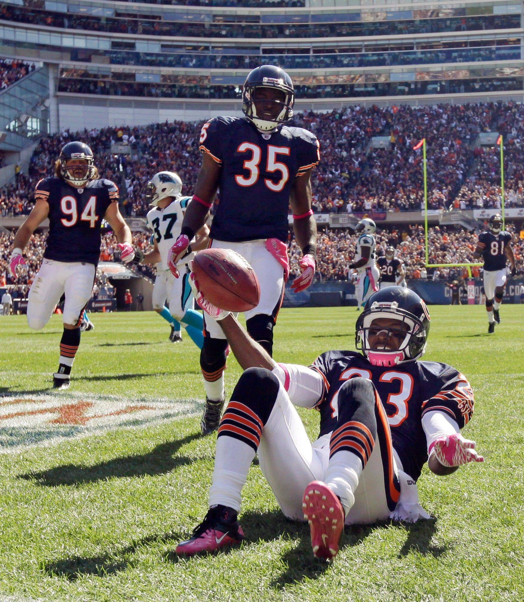 Bears kick returner Devin Hester somersaults into the end zone Sunday after returning a punt 69 yards for a touchdown against the Carolina Panthers at Soldier Field.