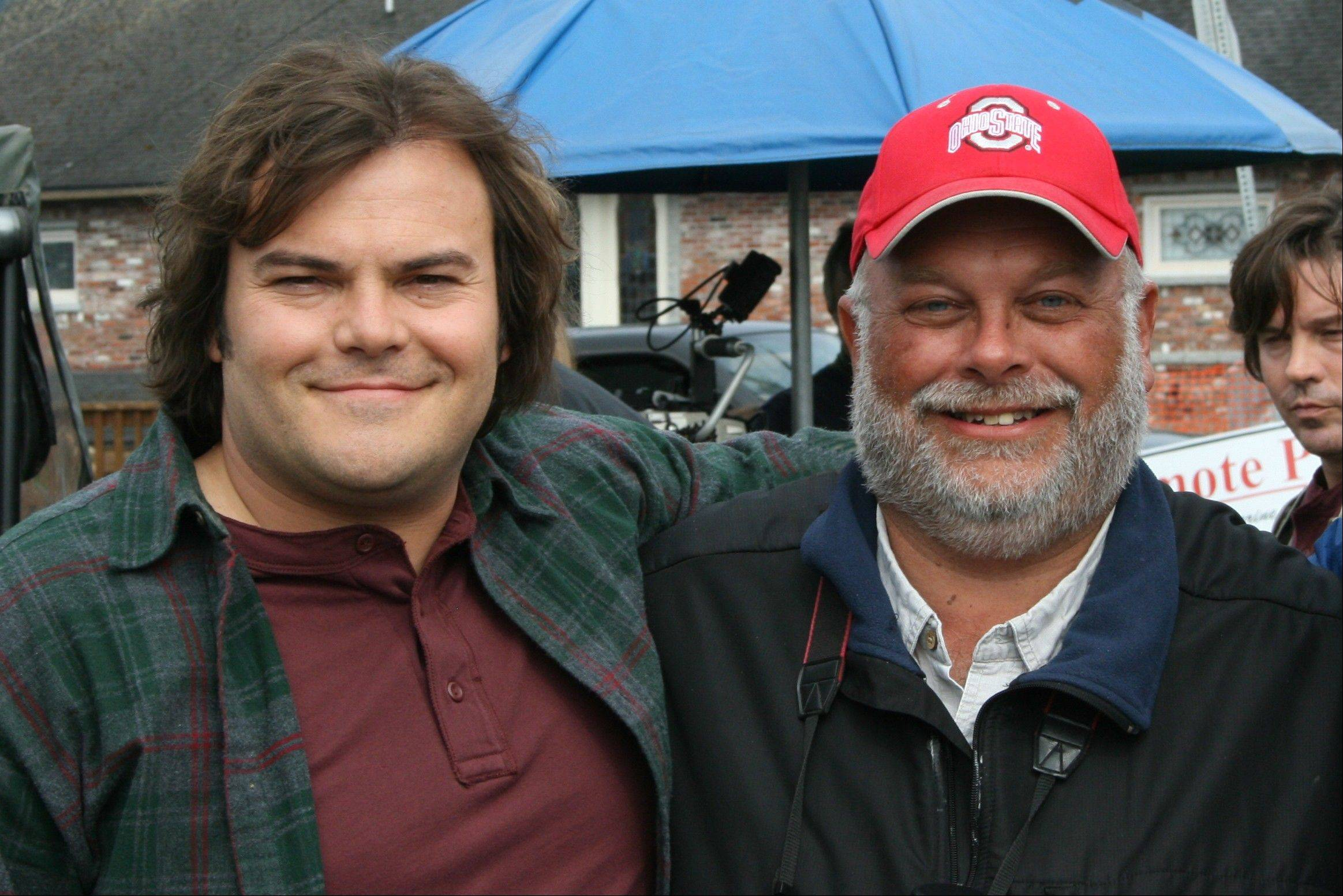 "Jack Black, left, portrays underdog Greg Miller in a yearlong bird spotting competition in the movie ""The Big Year,"" opening Oct. 14. Miller served as a consultant on the movie (and makes a cameo in his red Ohio State cap) and says he thinks the movie will draw people into the hobby."