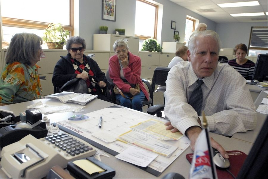 Deputy Elk Grove Township Assessor Steven Eul works to get the deductions that Evelyn Johnson, left, has coming for her. Neighbors Toni Prepp and Phyllis Pendleton joined Johnson Tuesday at the township offices.