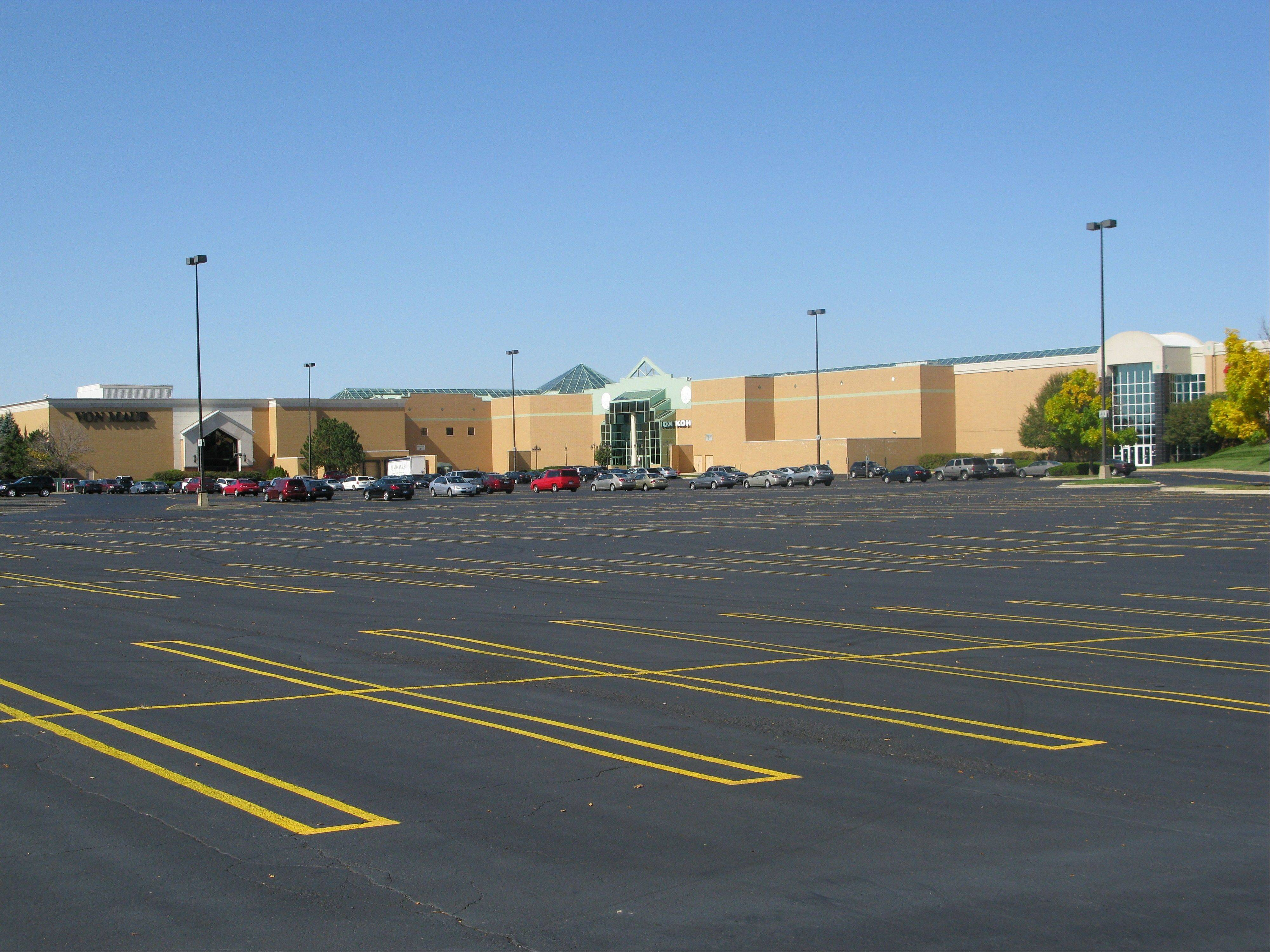Parking spaces are abundant at Charlestowne Mall as tenants inside await the promise of an indoor ice rink and more restaurants to bring foot traffic to their businesses.
