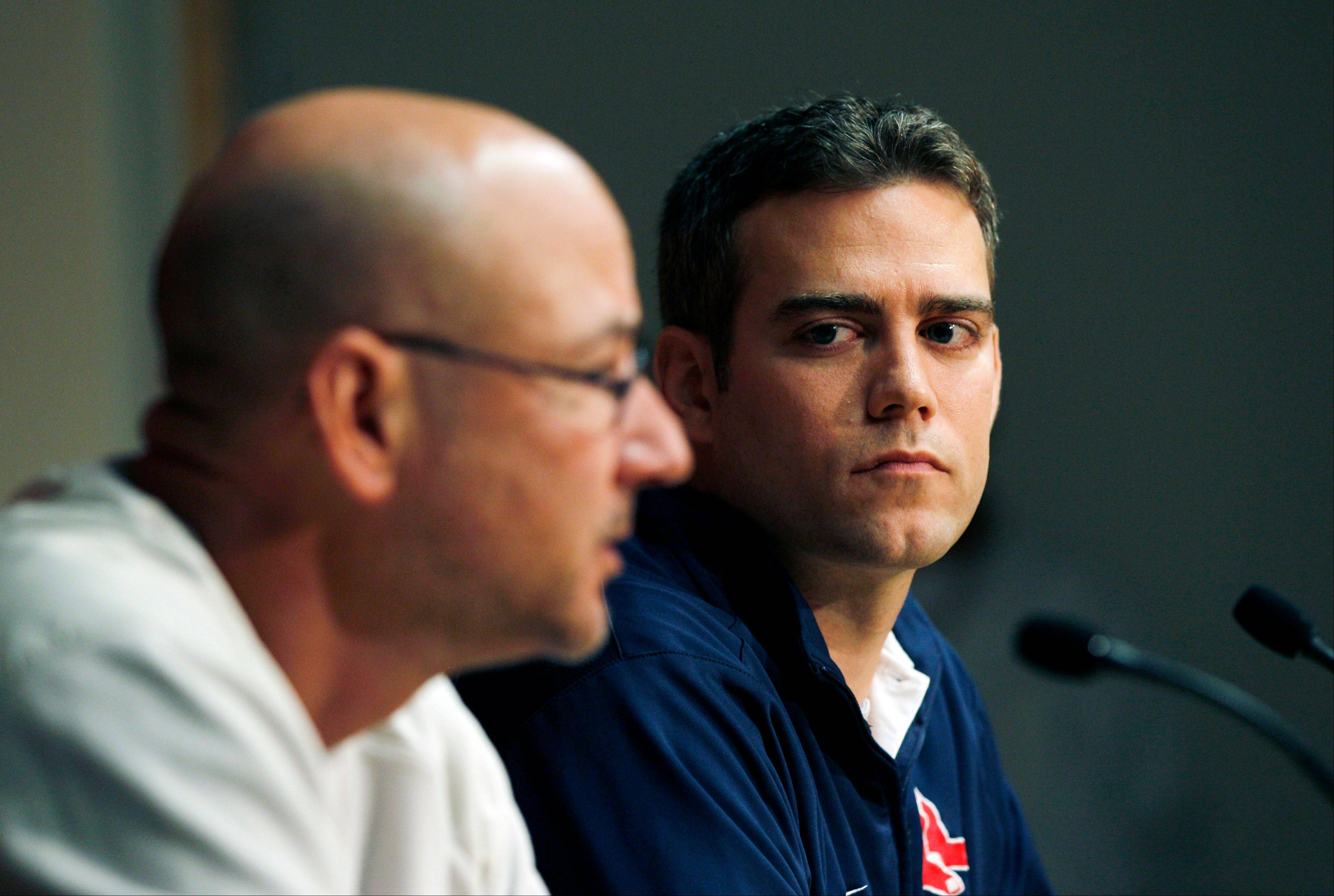 Boston Red Sox manager Terry Francona, left, speaks as general manager Theo Epstein listens during a news conference at Fenway Park after they were eliminated from participating in the baseball playoffs.