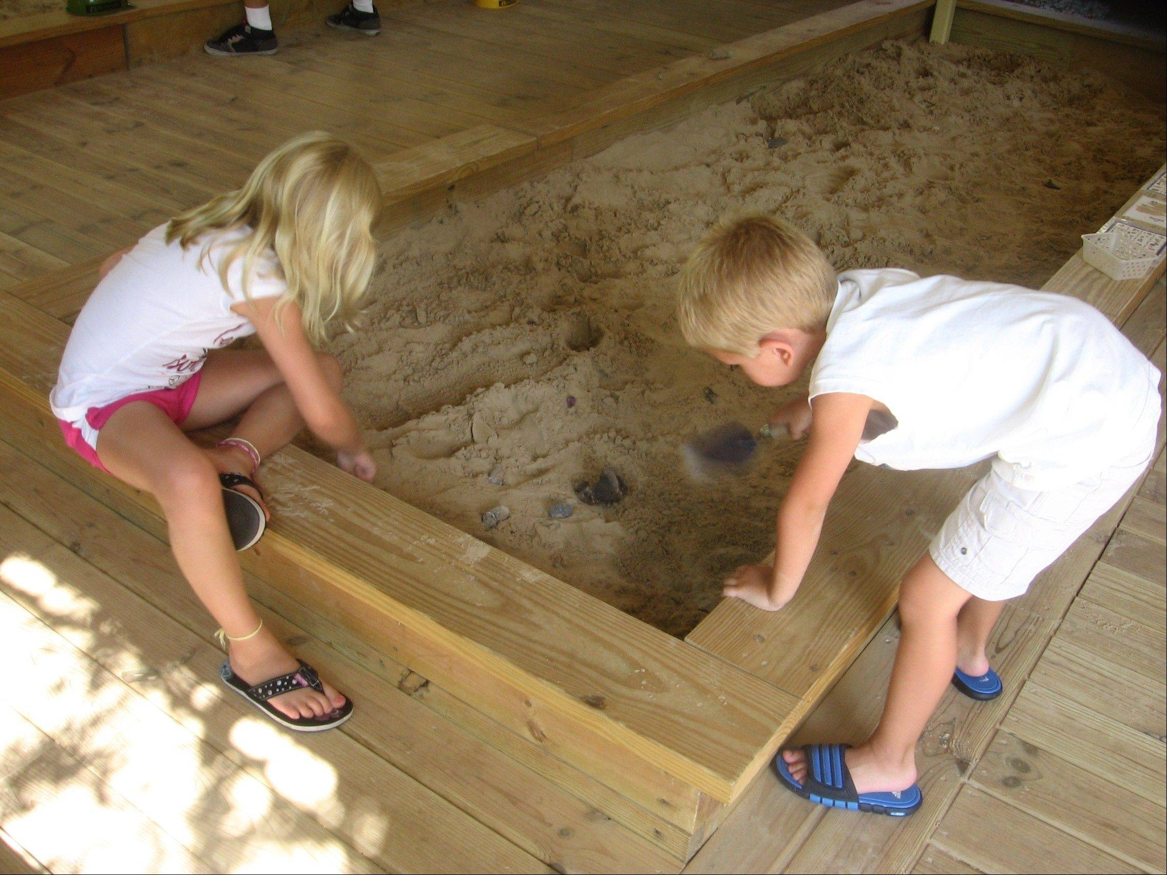 Jamie SotonoffA free sandbox outside Wisconsin's Cave of the Mounds allows children to dig for hidden gemstones and fossils.