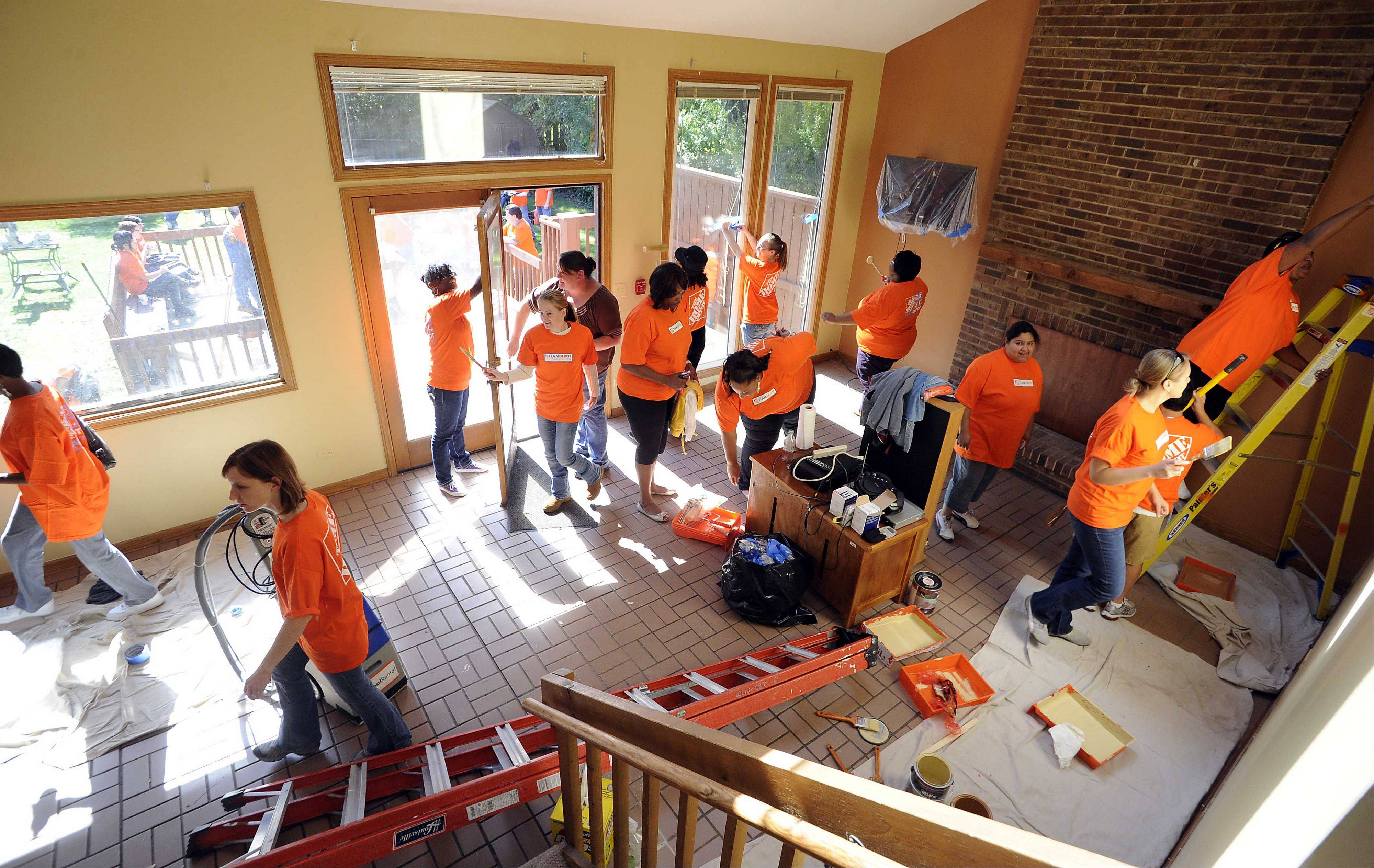 About 50 Home Depot employees Tuesday joined workers and Little City Foundation representatives to renovate one of the Little City Community Integrated Living homes in Palatine.