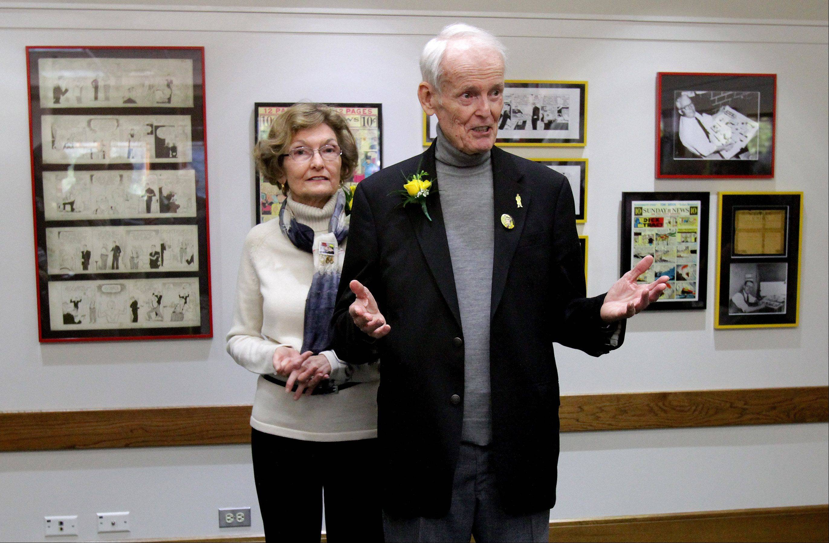 Dick Tracy artist Dick Locher, with his wife Mary, speaks at the dedication of the Century Walk Artist Gallery at the Naperville Township building Tuesday on the 80th birthday of Dick Tracy.