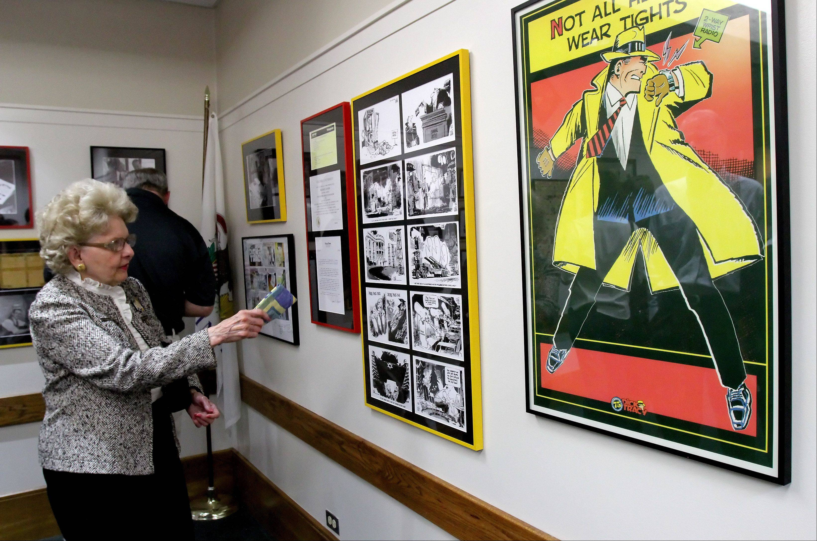 Jean O'Connell of Geneva, daughter of Chester Gould, looks at the Dick Tracy artwork during the dedication of the Century Walk Artist Gallery on Tuesday.