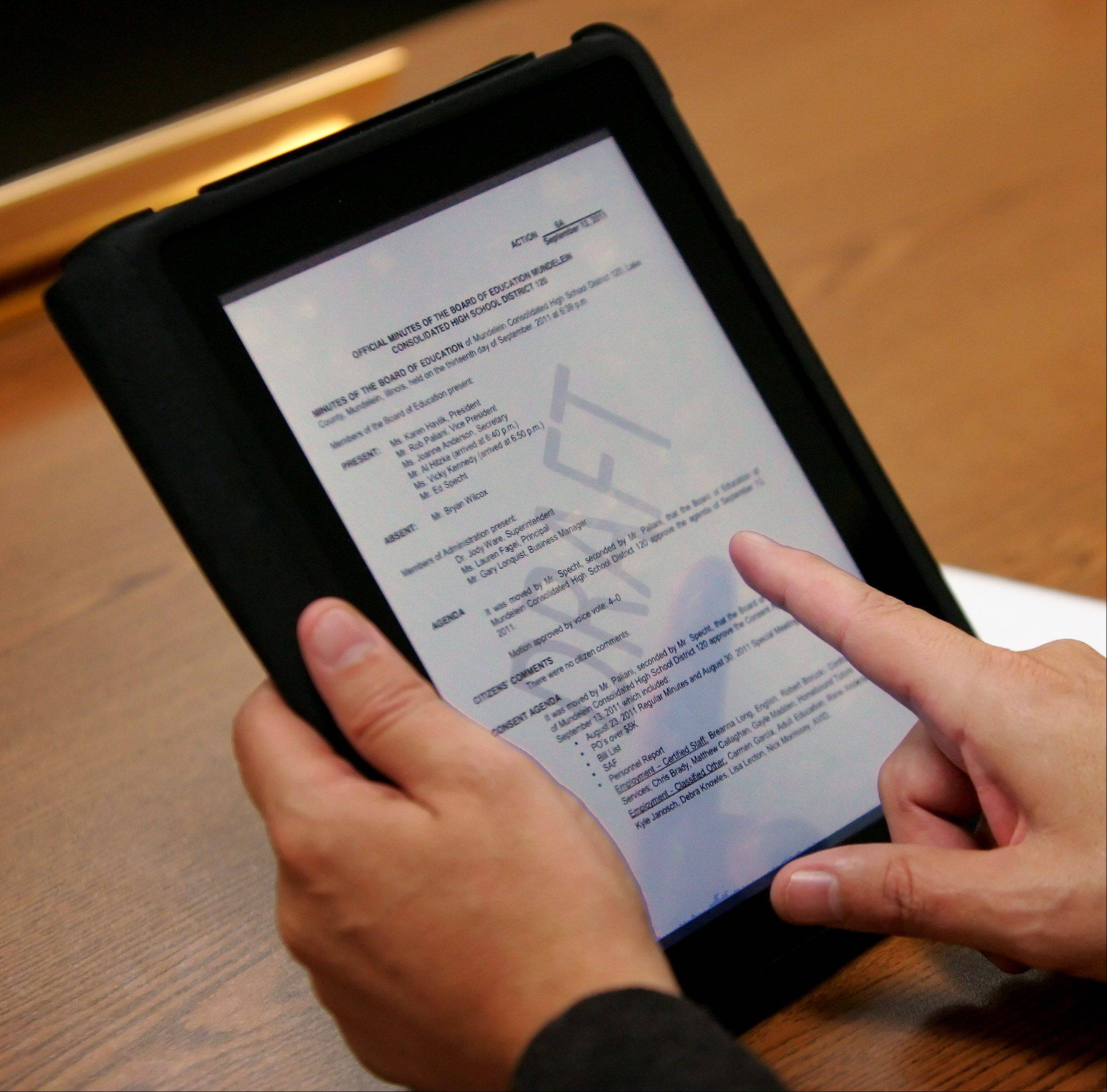 Board members representing the Mundelein High School District and other government agencies have traded thick paper packets for iPads that allow them to read important documents digitally. A Chicago-area government watchdog supports paperless meetings but reminded politicians that publicly owned iPads are subject to review under the Freedom of Information Act.