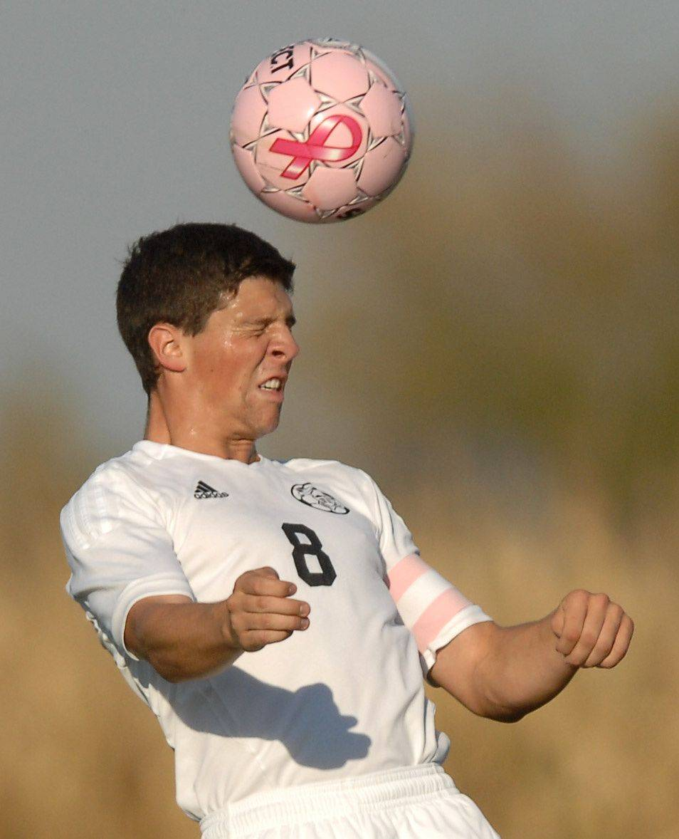 Kaneland's Alex Gil heads the ball against Rochelle Thursday in Maple Park.